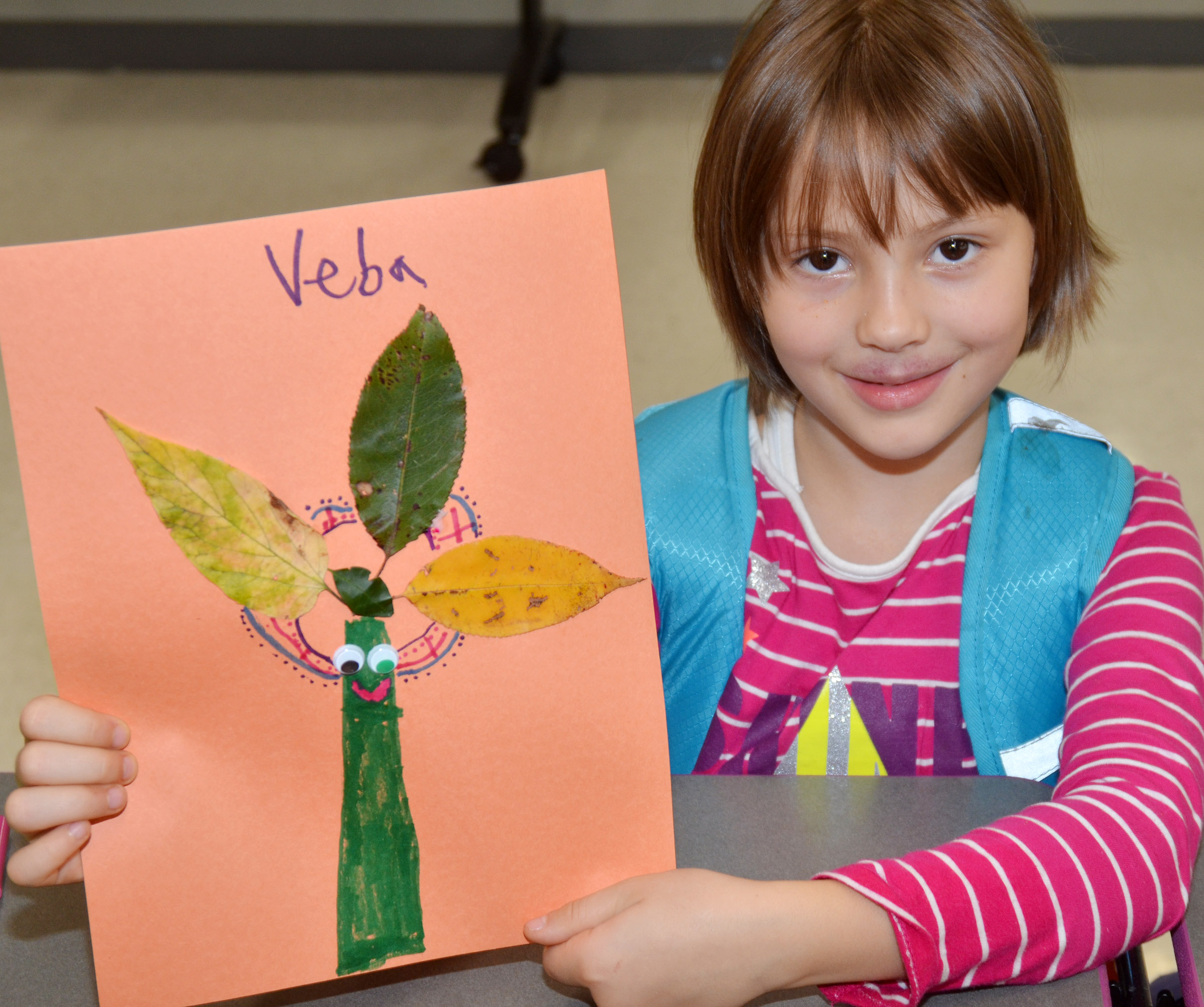 CES first-grader Veda Burgess holds her leaf animal.