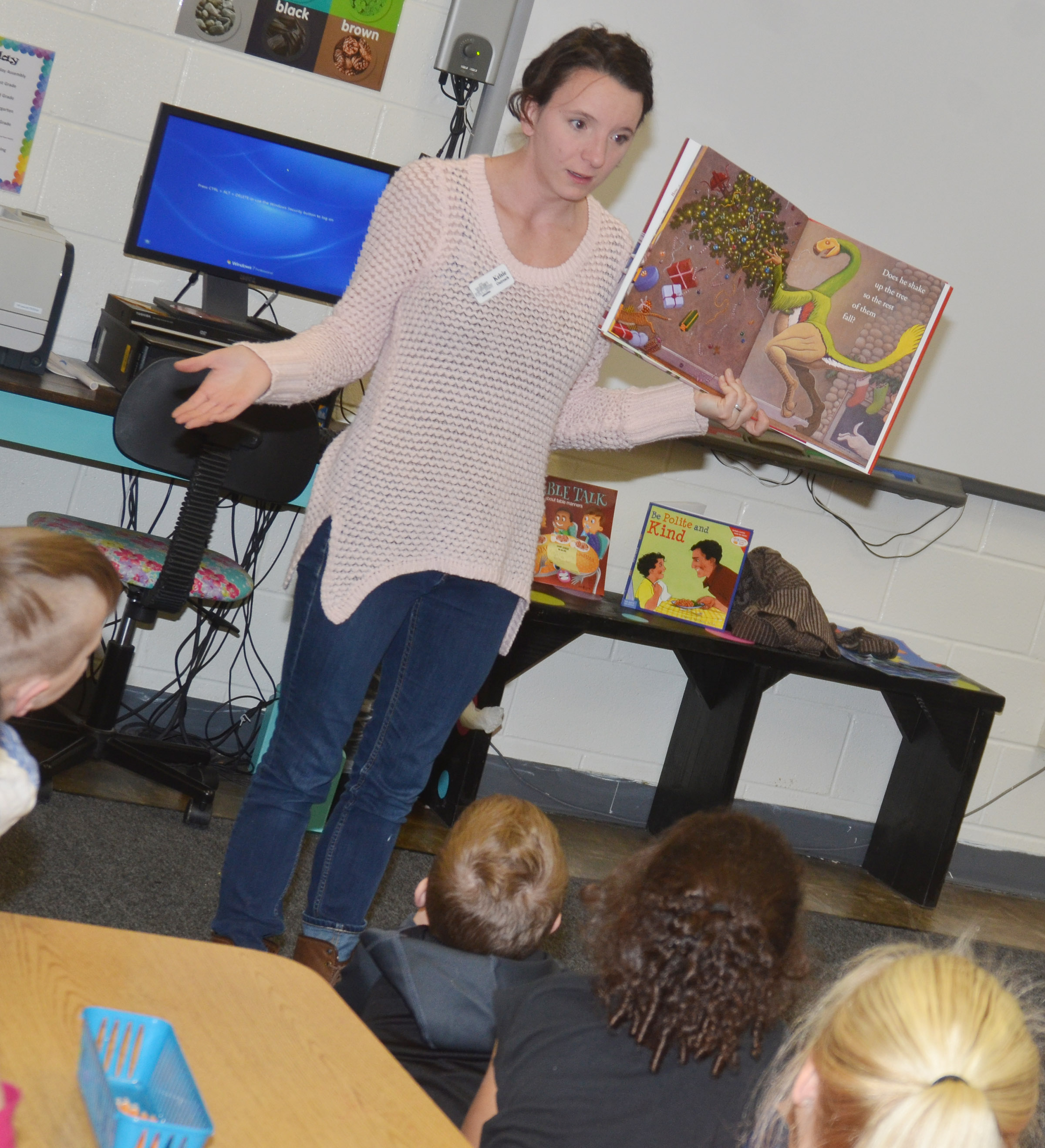 Kelsie Pepper from the Taylor County Public Library reads Christmas books to CES first-graders.