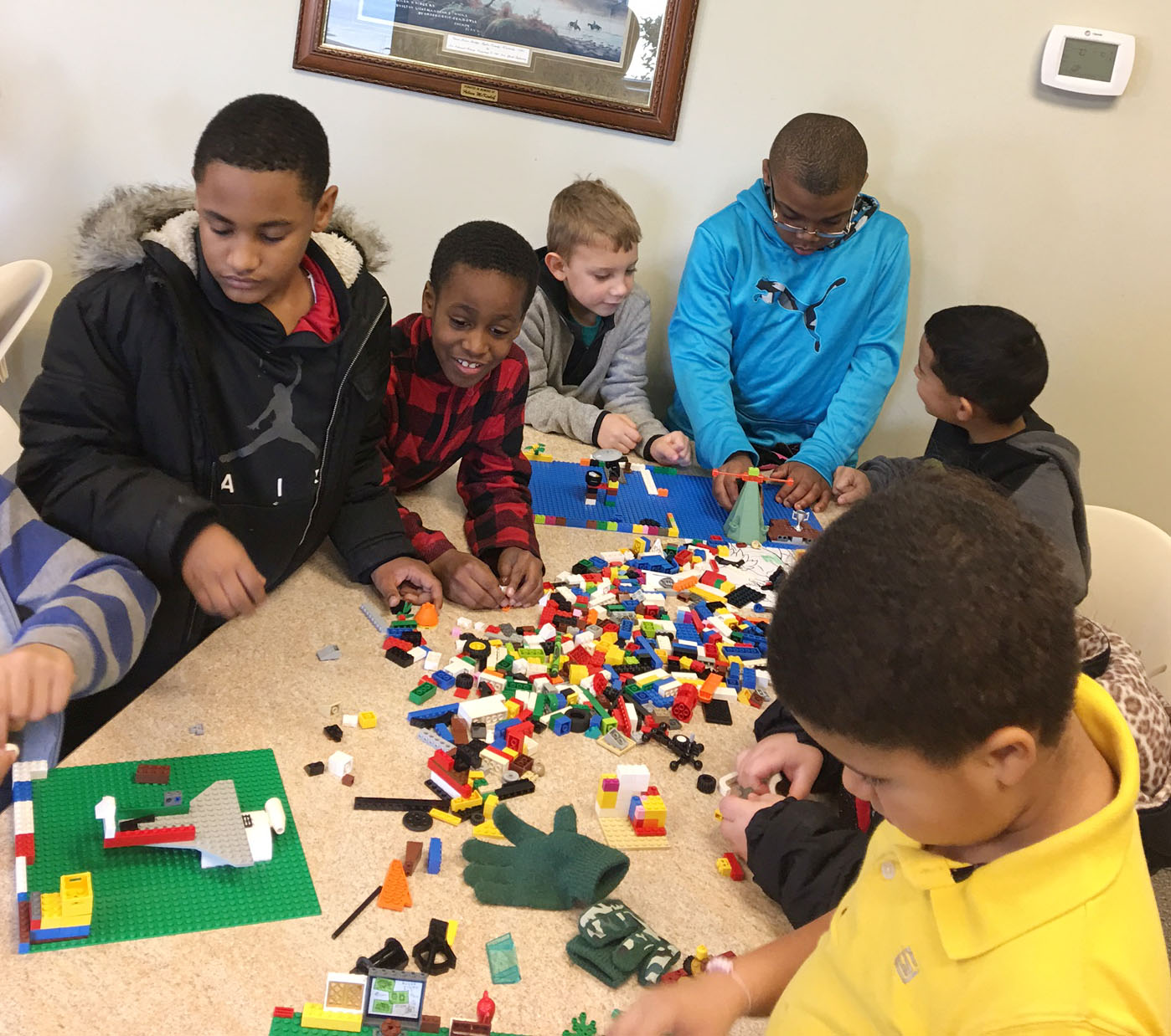 CES Wings Express students build with Legos. From left are third-graders Shaiden Calhoun and John Gholston, first-grader Gabe Prior and third-grader Austin Sloan, with their classmates.