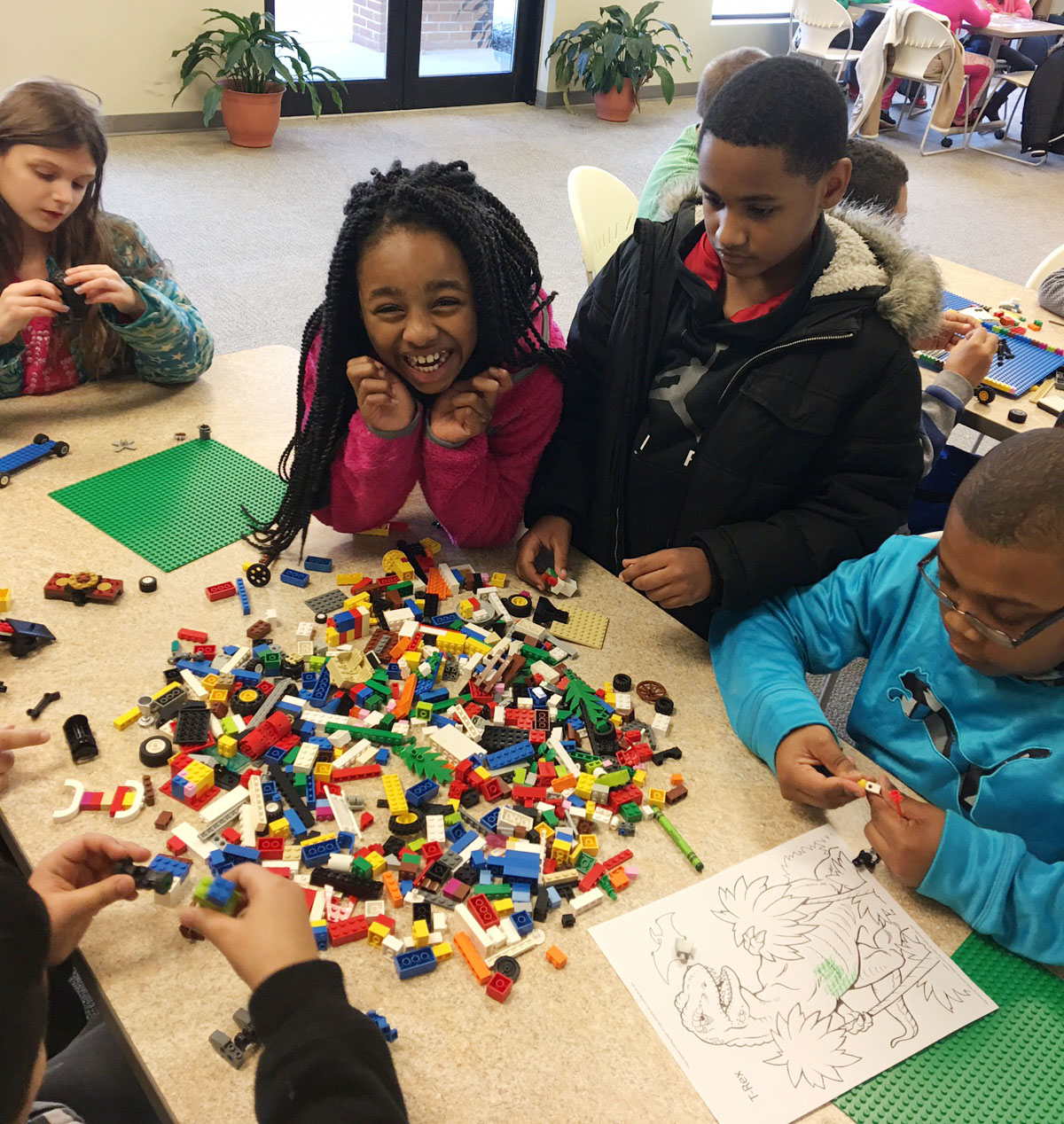 CES Wings Express students have fun building with Legos. From left are third-graders Madie Gebler, Tiffani Gaddie, Shaiden Calhoun and Austin Sloan.