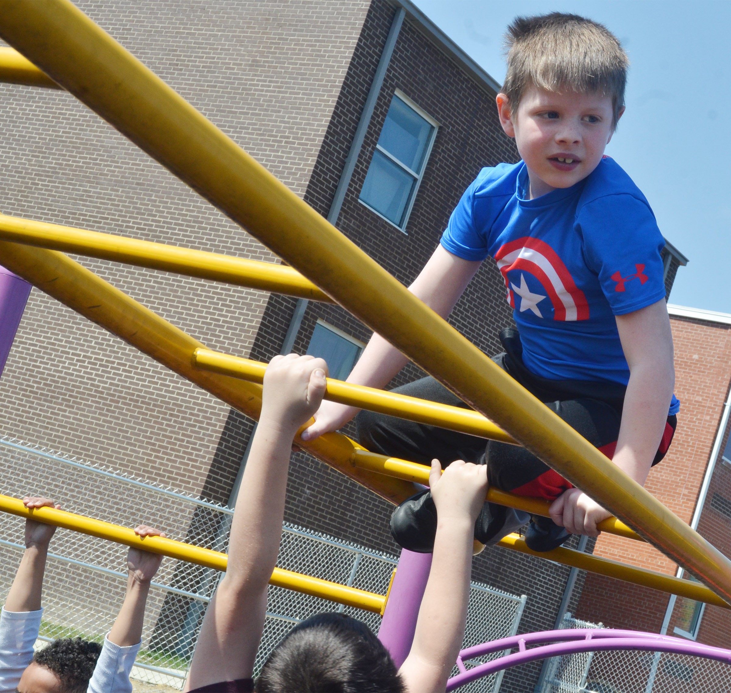 CES first-grader Brody Sidebottom climbs.