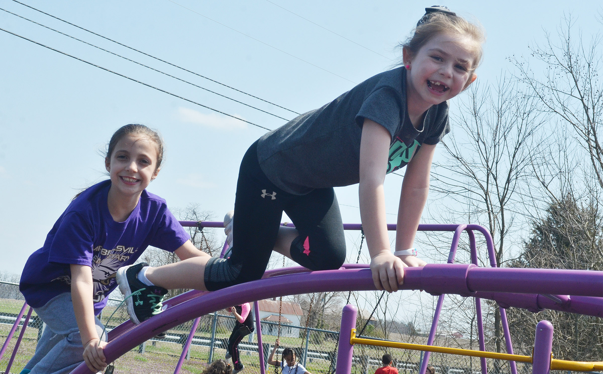CES first-graders Lillian Martin, at left, and Lainey Price climb together.