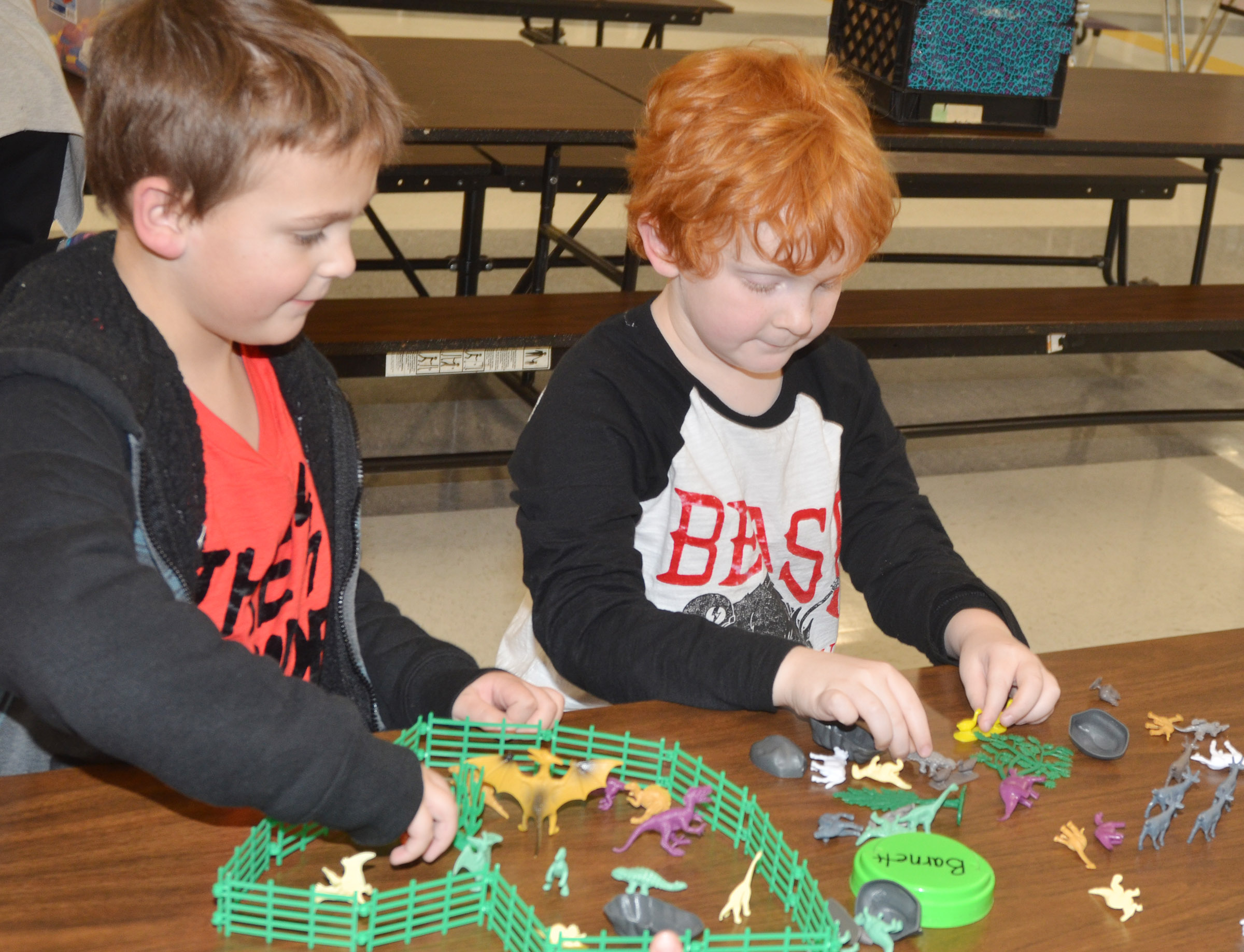 CES first-grader Brendan Martin, at left, and his brother, Gavin, a second-grader, play with dinosaurs together.