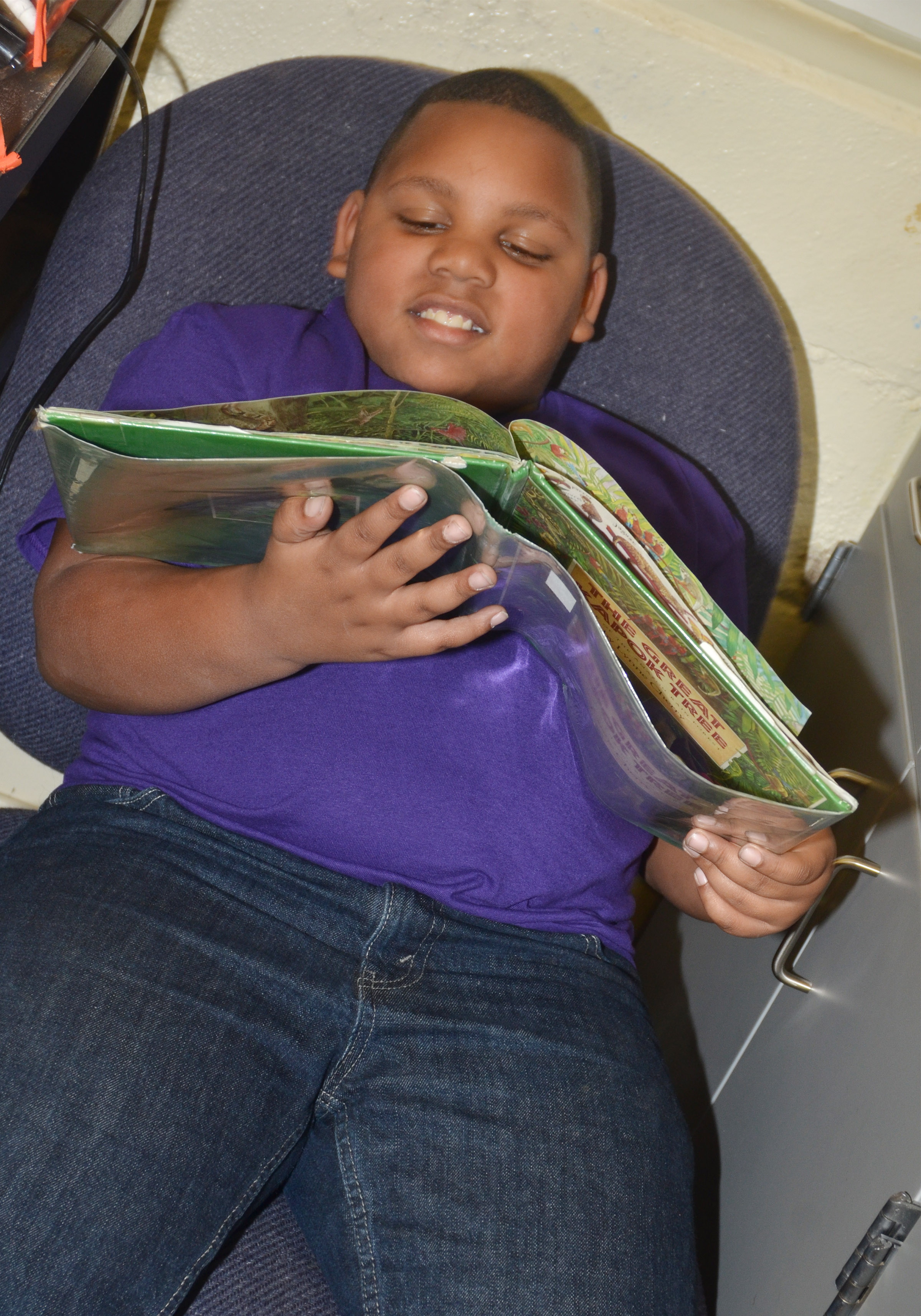 CES third-grader Malikiah Spurling reads at Wings Express.