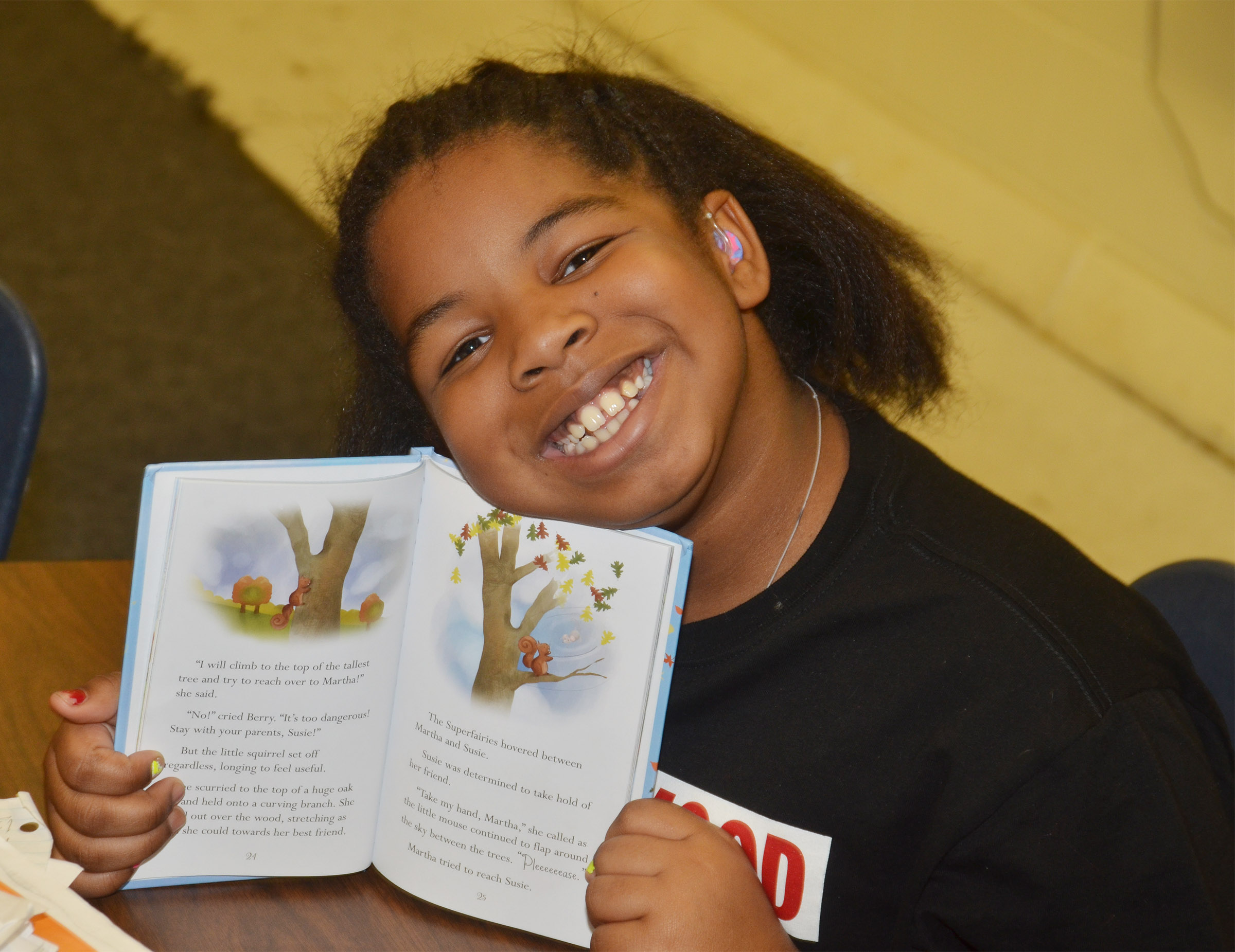 CES third-grader KaMiya Williams enjoys reading at Wings Express.