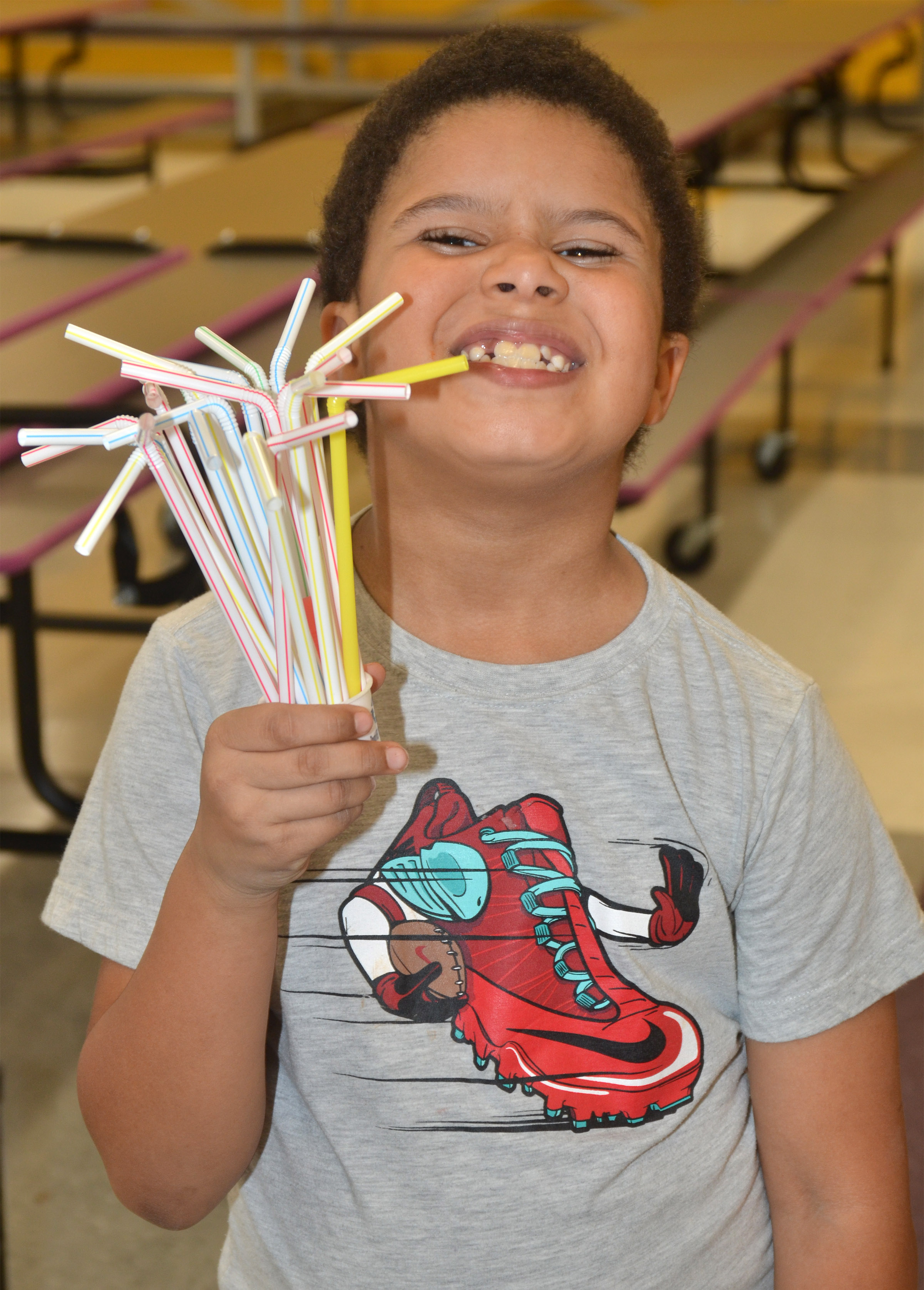 CES first-grader Navon Copeland smiles with the sculpture he made out of Play-Doh and straws.