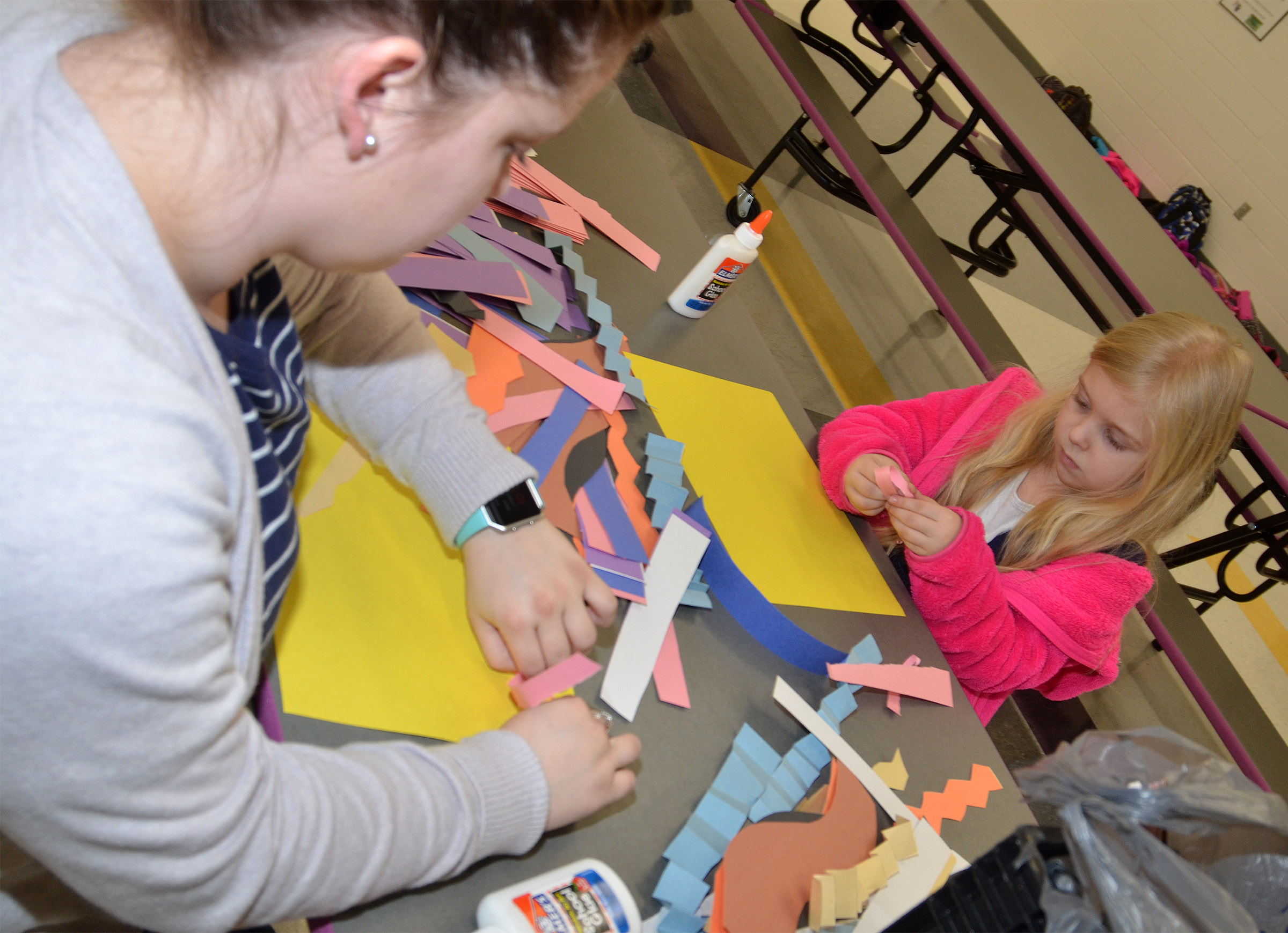 Campbellsville University education student Jordan Bray helps CES kindergartener Jordan Bray make a sculpture out of paper.