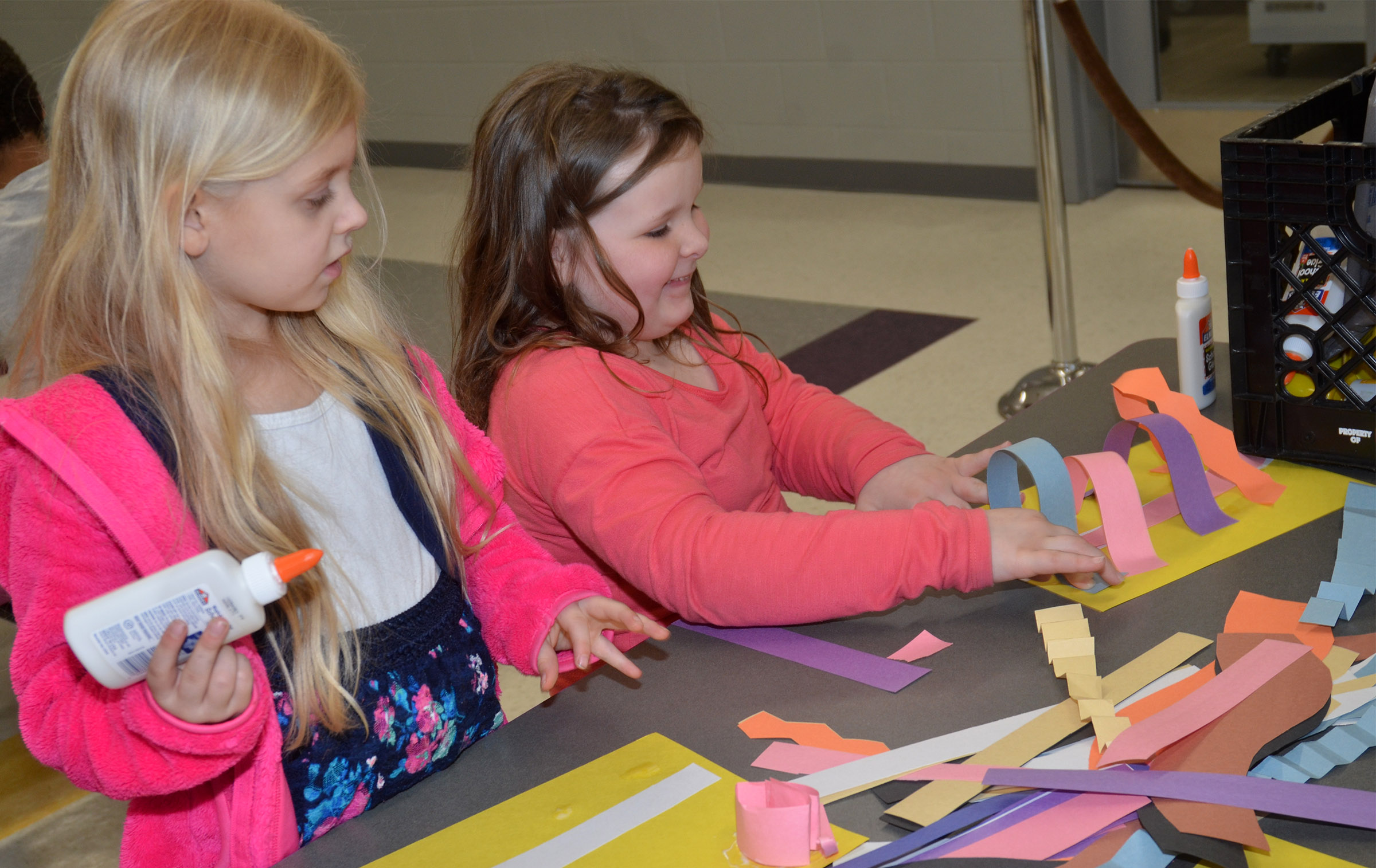 CES kindergartener Aubrey Novak, at left, and first-grader Kierra Maupin make sculptures out of paper.