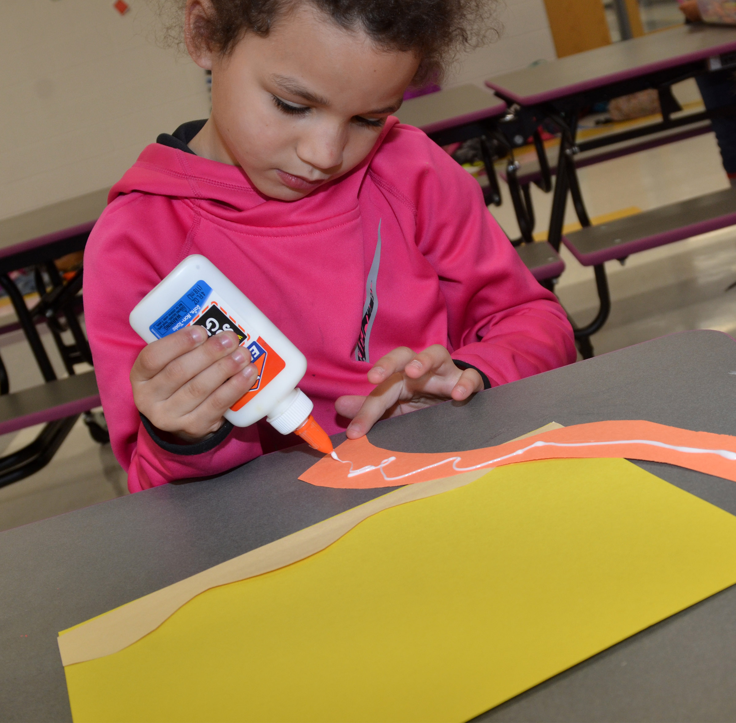 CES kindergartener Aleeya Spaulding makes a sculpture out of paper.