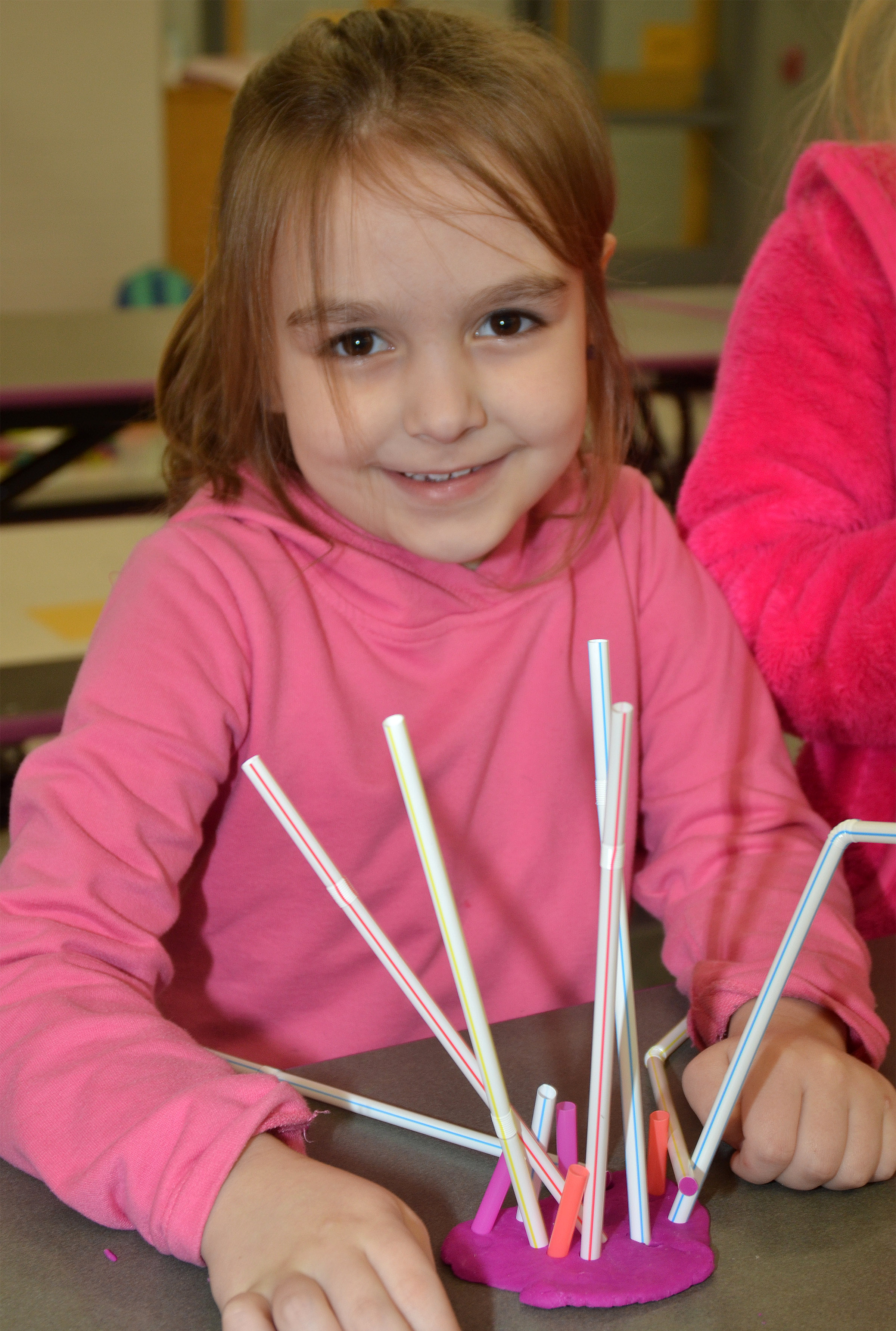 CES kindergartener Aubrey Allen smiles with the sculpture she made out of Play-Doh and straws.