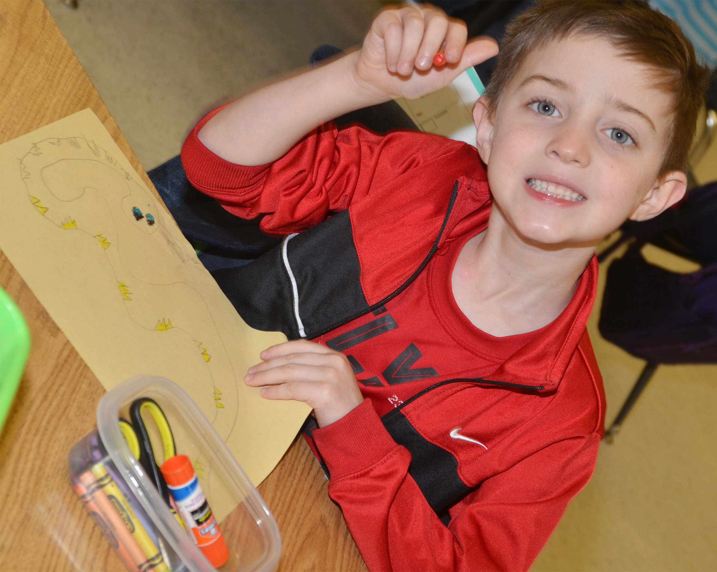 CES kindergartener Caleb Goodson colors his snake.