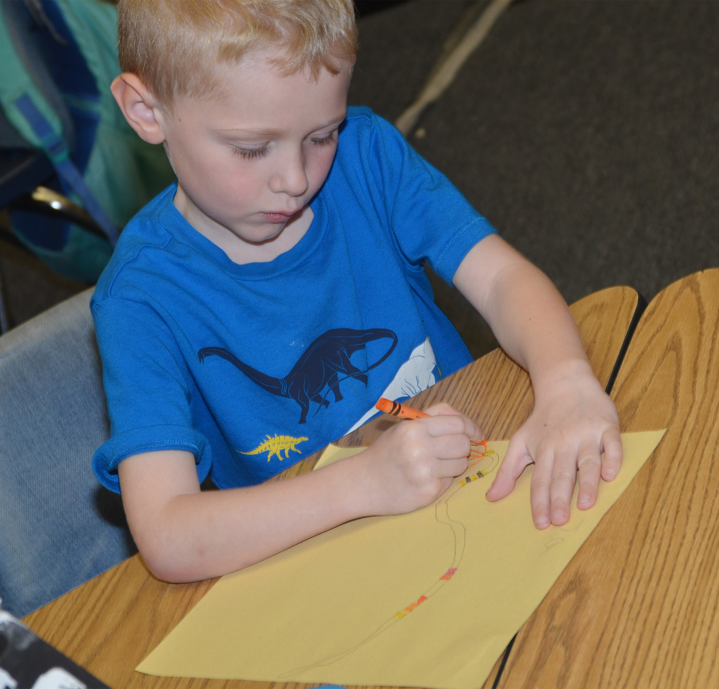 CES kindergartener Jackson Wright colors his snake.