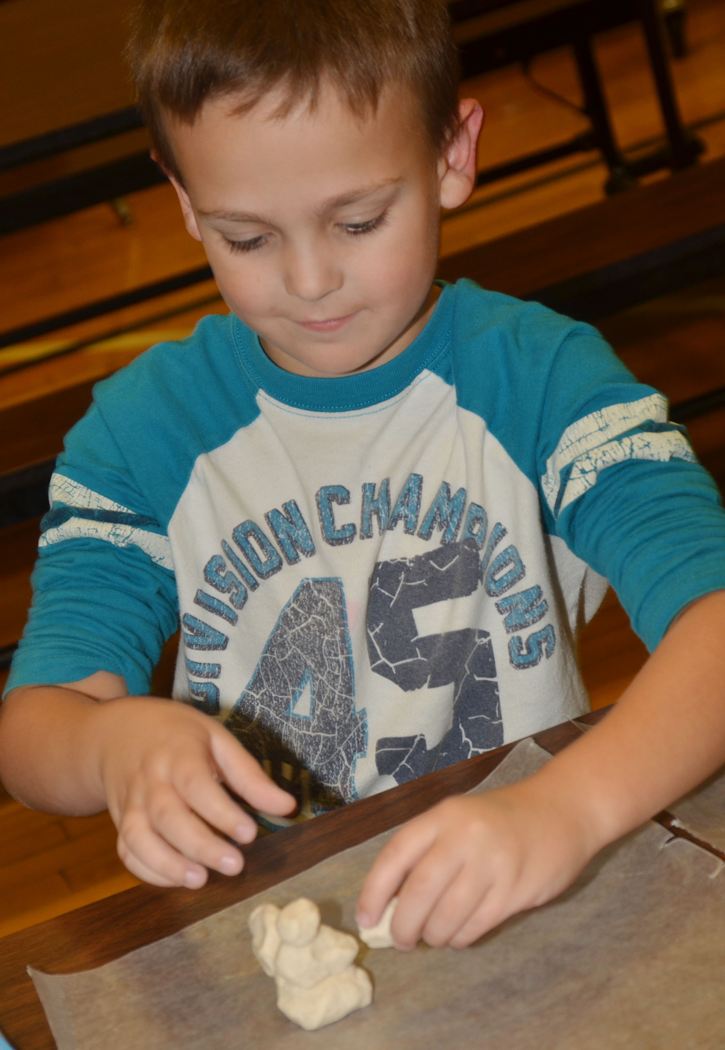 CES first-grader Brendan Martin uses salt dough to make his ornament.
