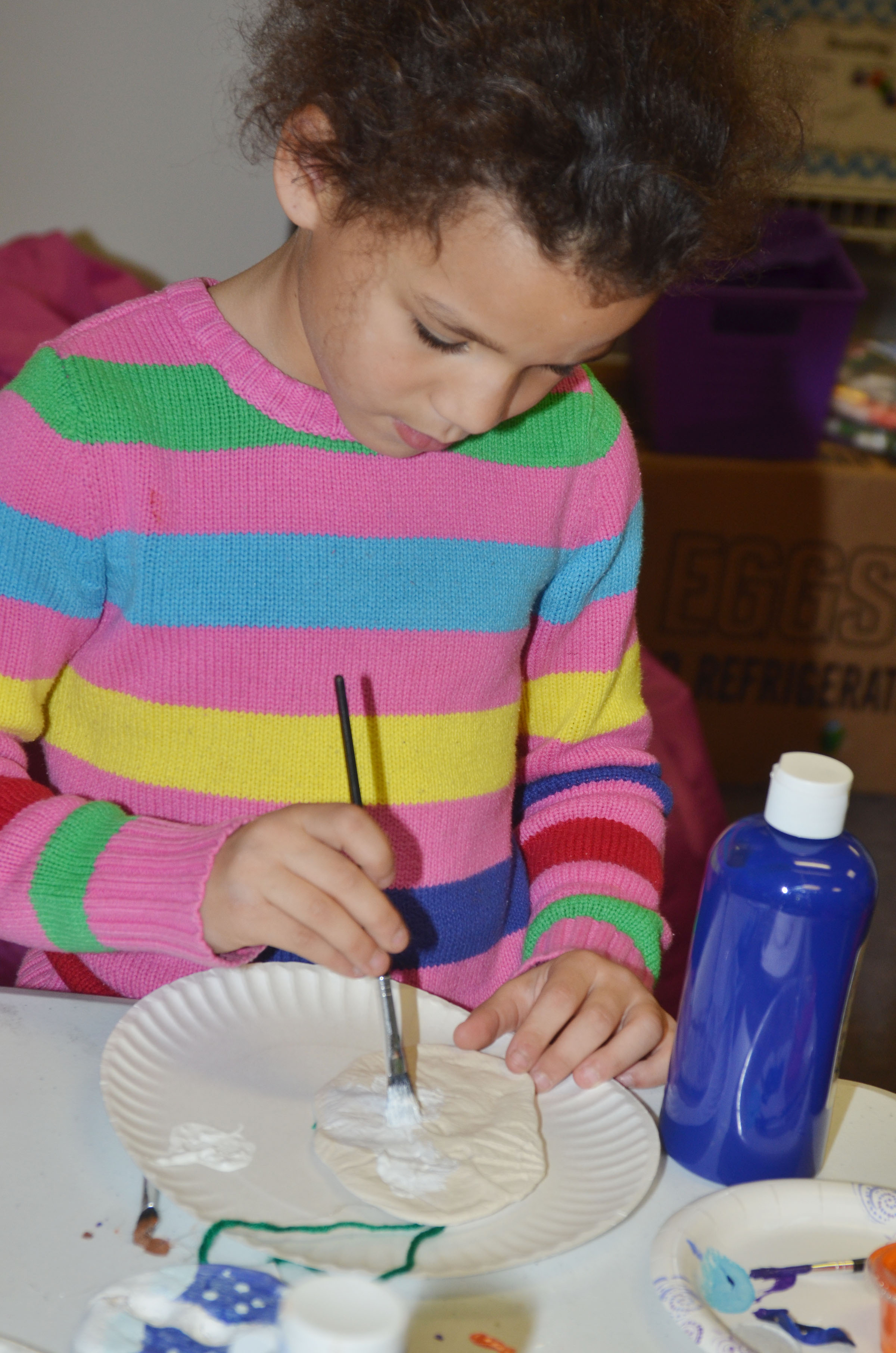 CES kindergartener Aleeya Spaulding paints her salt dough ornament.