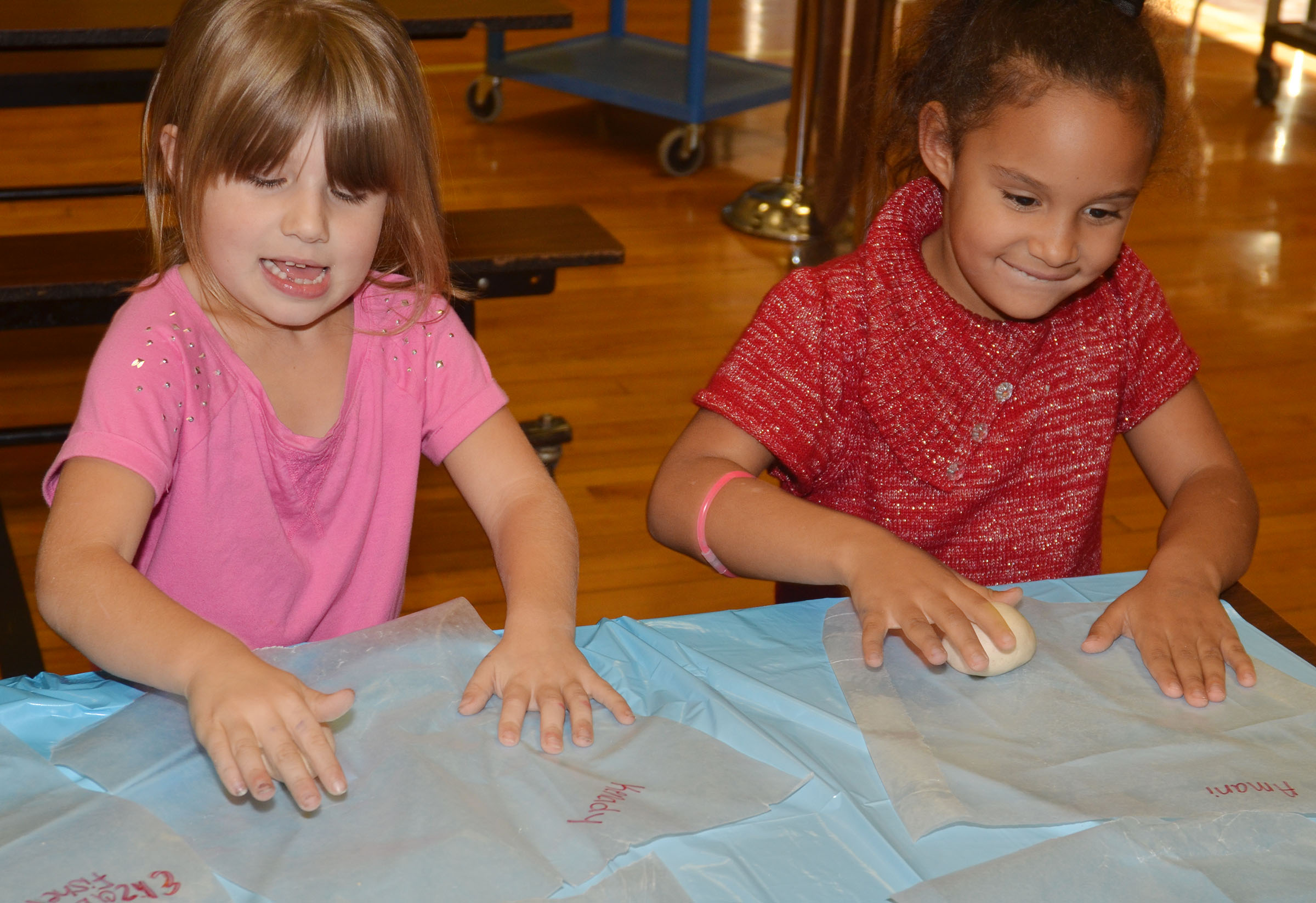 CES first-graders Kenady Gabehart, at left, and Amani Bridgewater smooth their salt dough into ornaments.