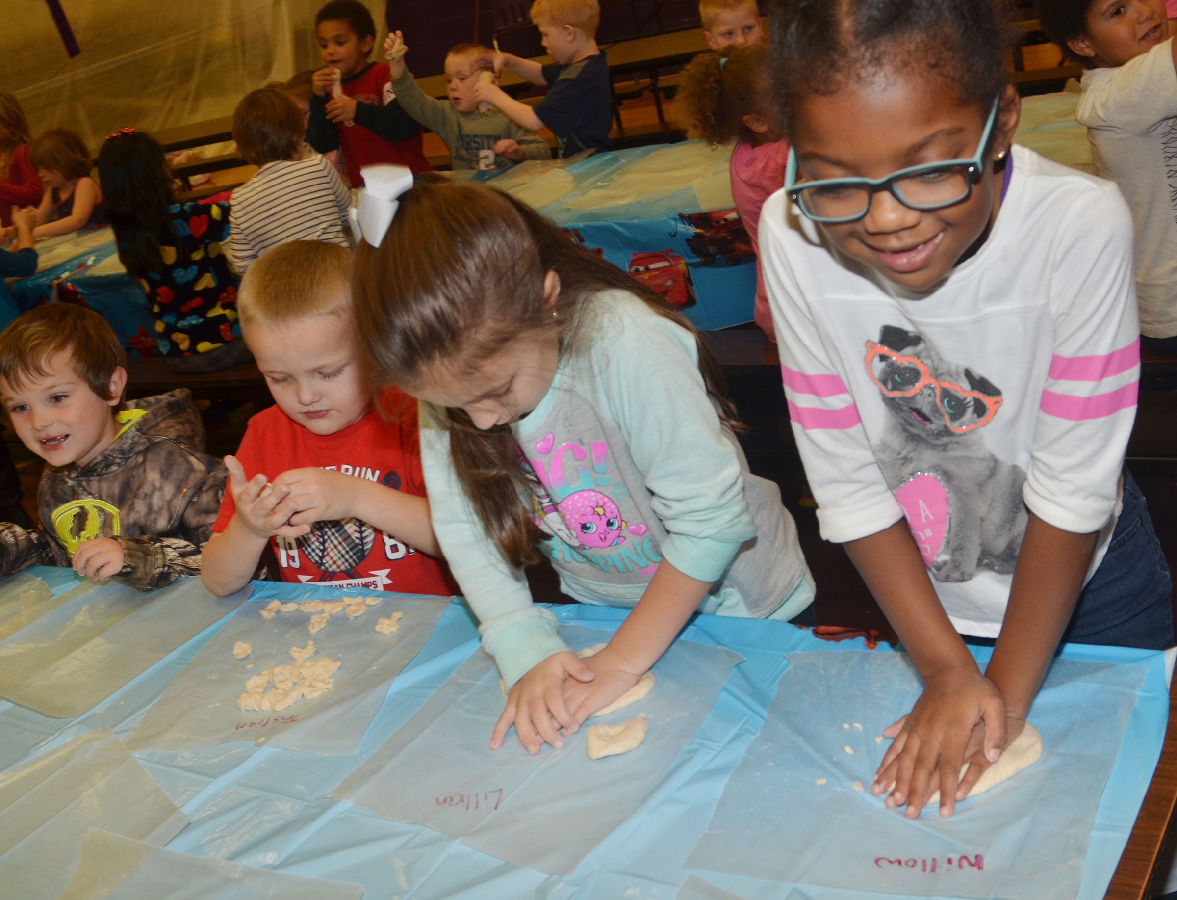 CES first-grader Willow Griffin, at right, and her Wings Express classmates make their salt dough ornaments.