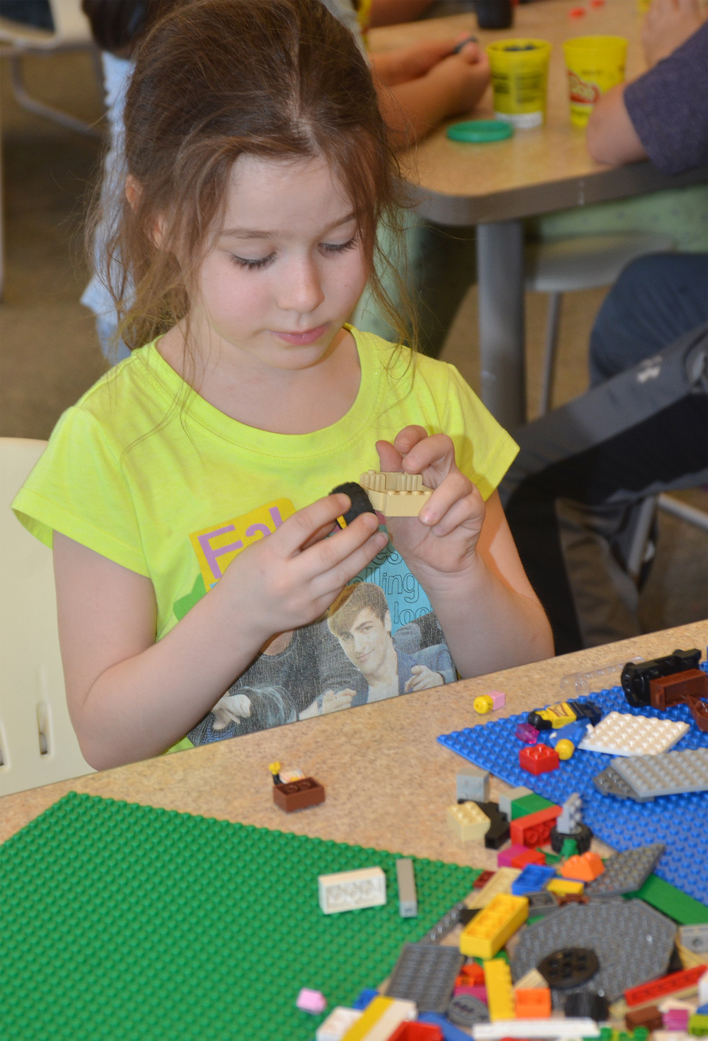 CES first-grader Stella Newcomb builds with Legos at the library.