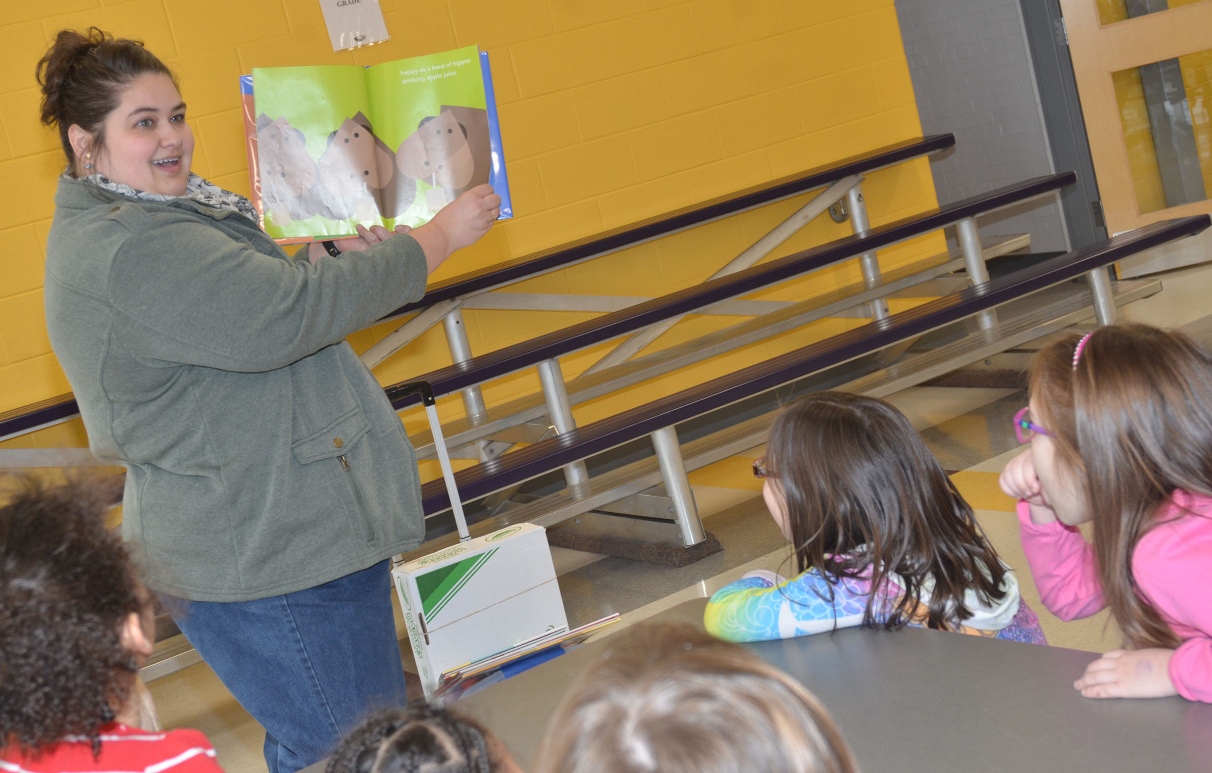 Sarah Hampton, Taylor County Public Library outreach librarian, reads a Valentine book to Wings Express students.