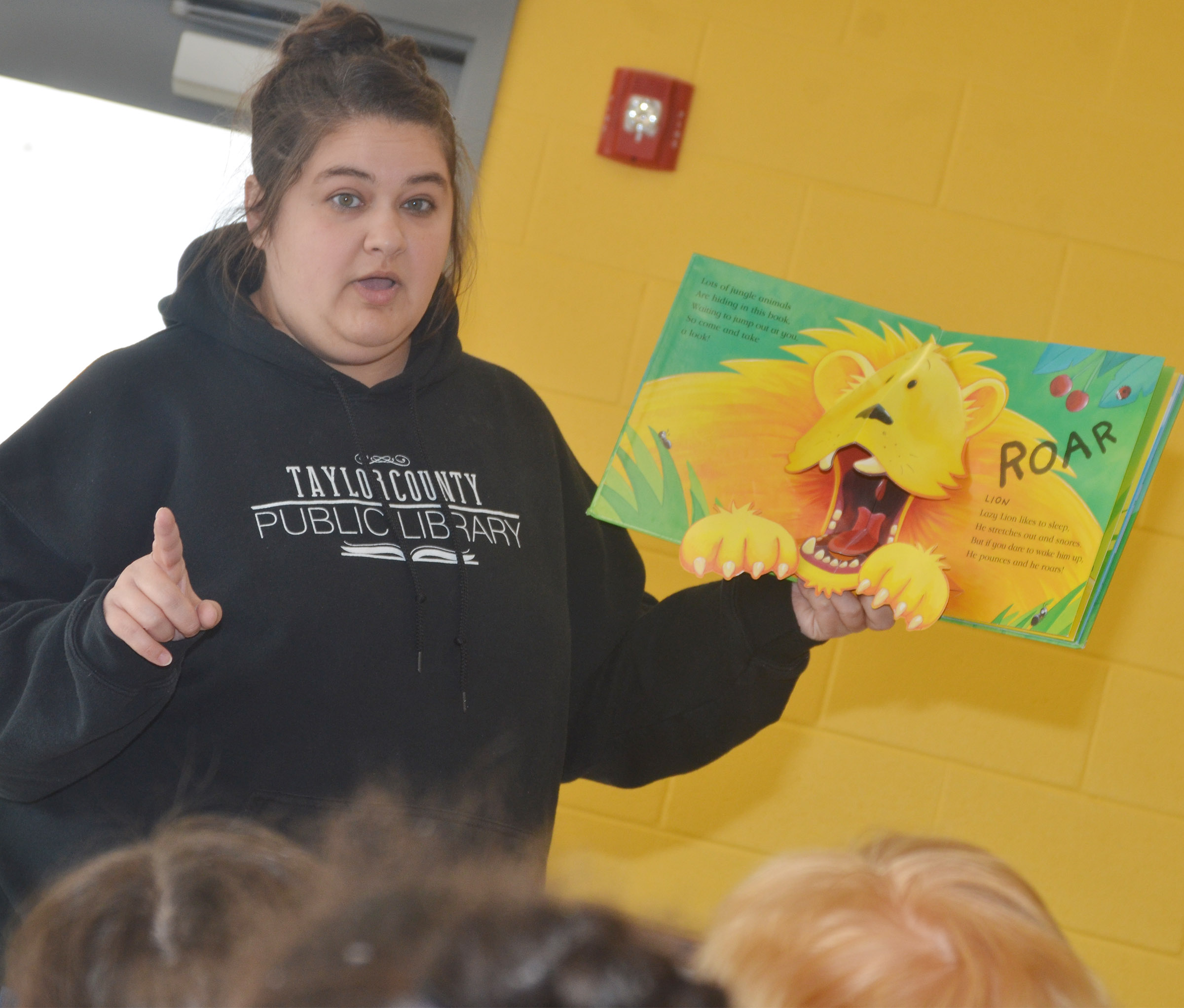 Sarah Hampton, Taylor County Public Library outreach librarian, reads to CES Wings Express students.