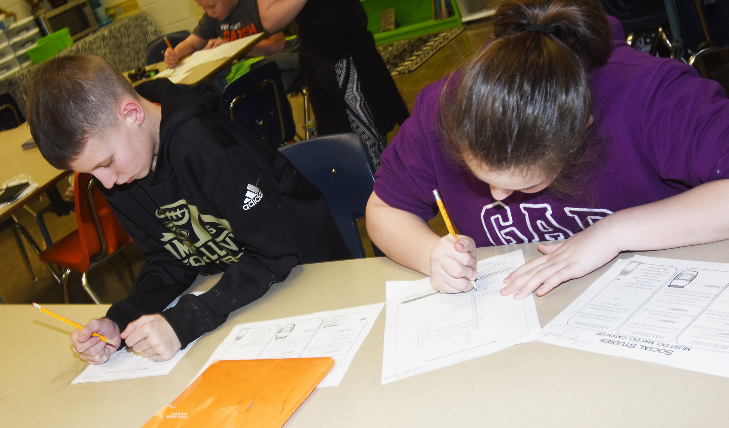 CES fifth-graders Rowan Petett, at left, and Riley Newton complete a branches of government crossword puzzle.