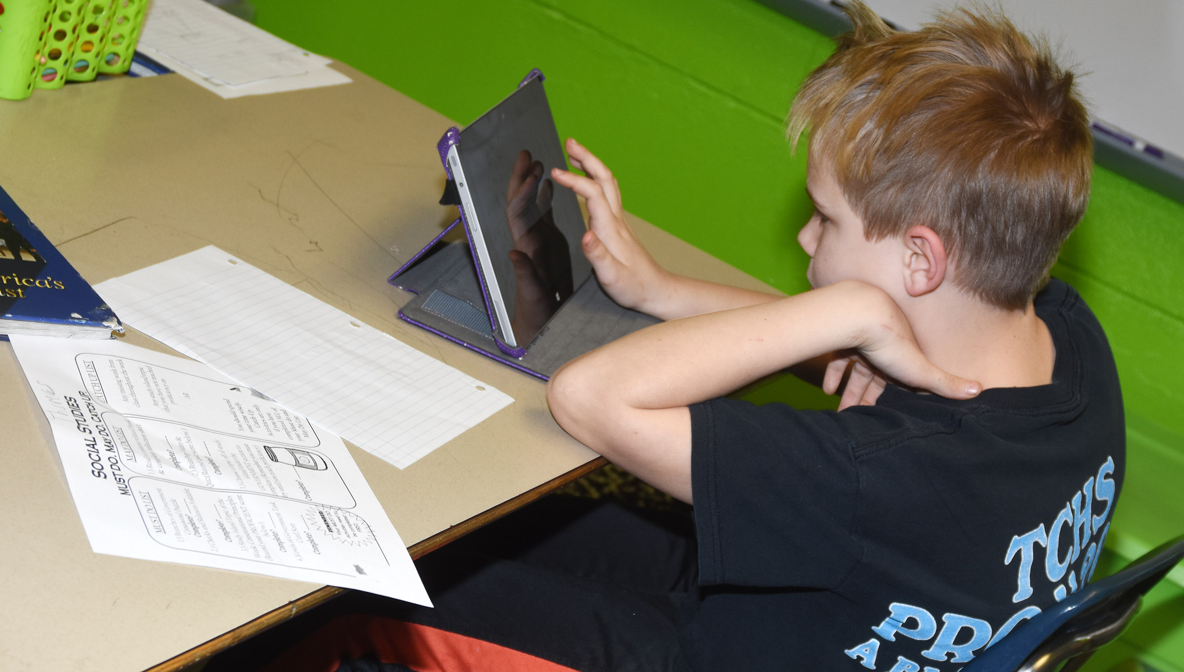 CES fifth-grader Thomas Tungate completes a branches of government lesson.