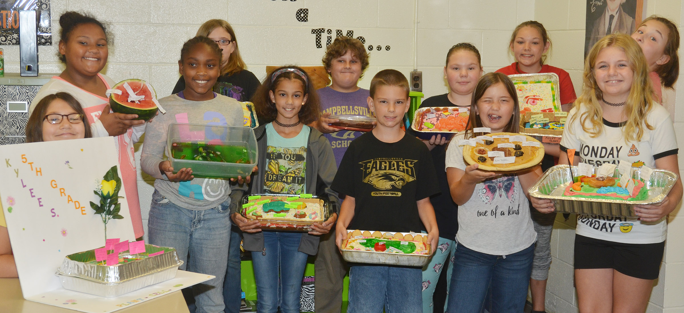 CMS fifth-grade science students hold their edible cells. From left, front, are fifth-graders Kylee Sowders, Ta'Zaria Owens, Mackenzie Negron, Taylan Hunt, Kate Billeter and Dakota Broyles. Back, Dezarae Washington, Destiny Lane, Zeke Harris, Averi Perkins, Piper Maggard and Riley Newton.
