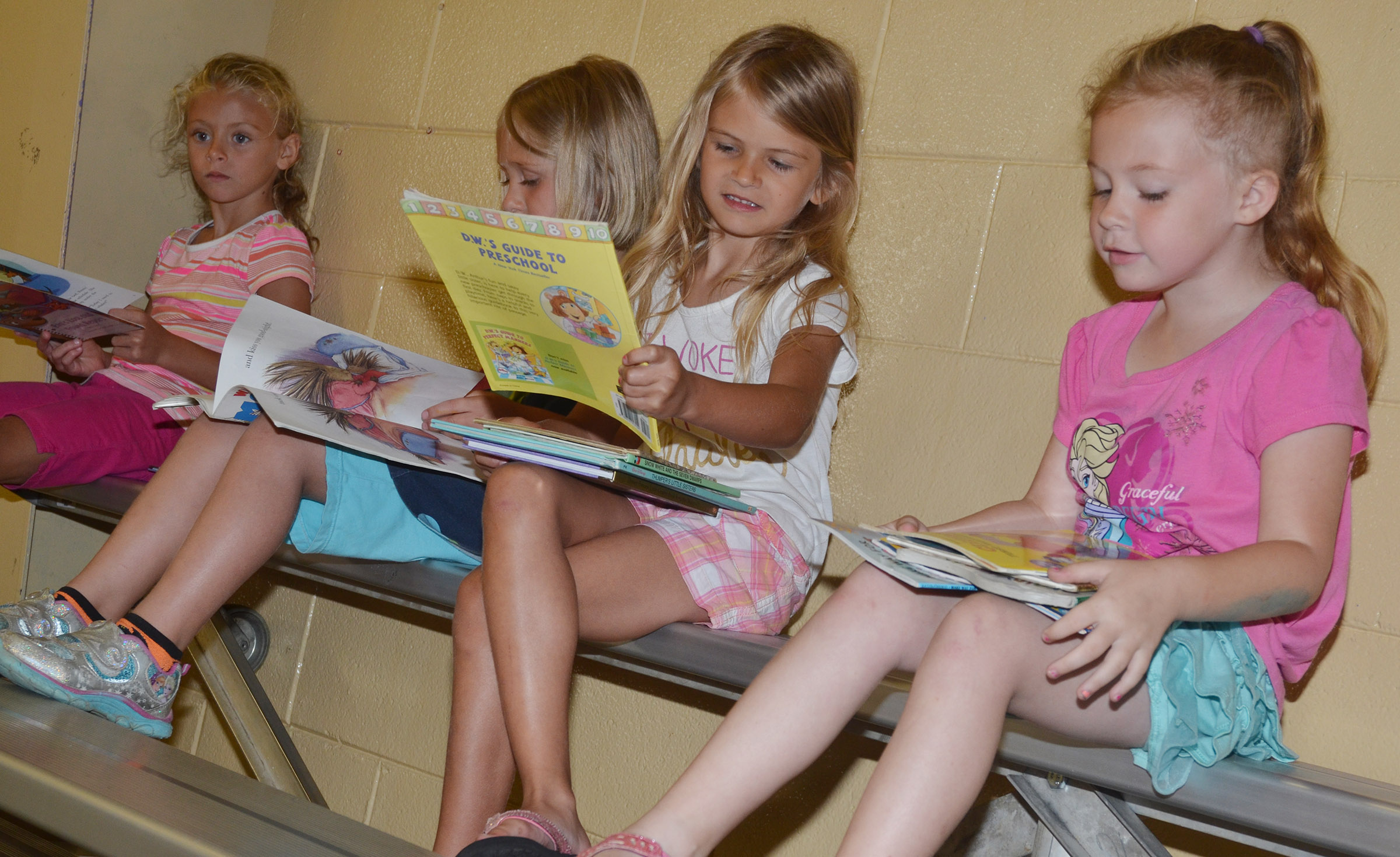 From left, CES kindergarteners Aliyah Litsey, LeeAnna Garvin, Gracie Gebler and Ava Caffee read together.