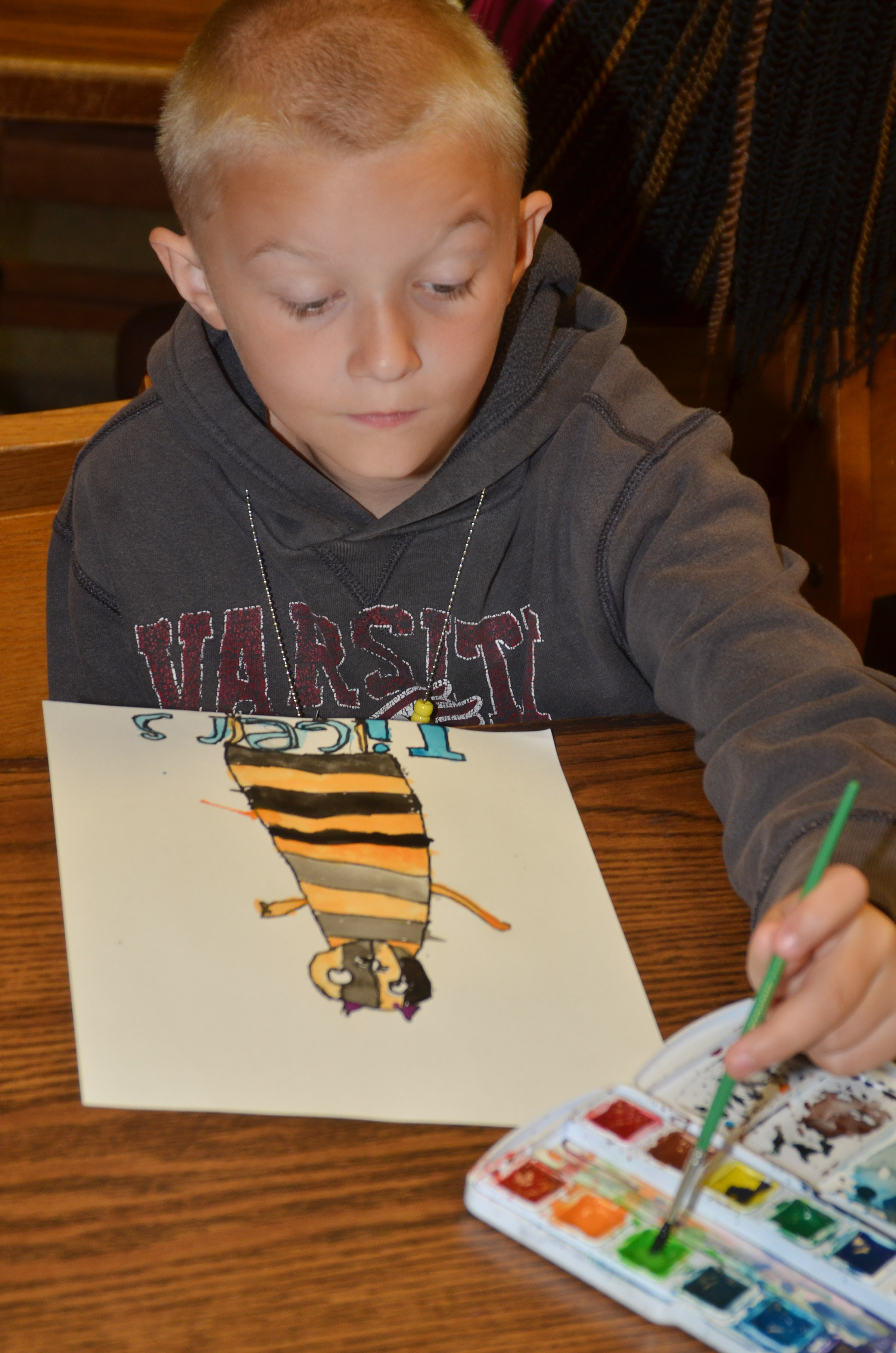 CES second-grader Camren Skaggs paints.