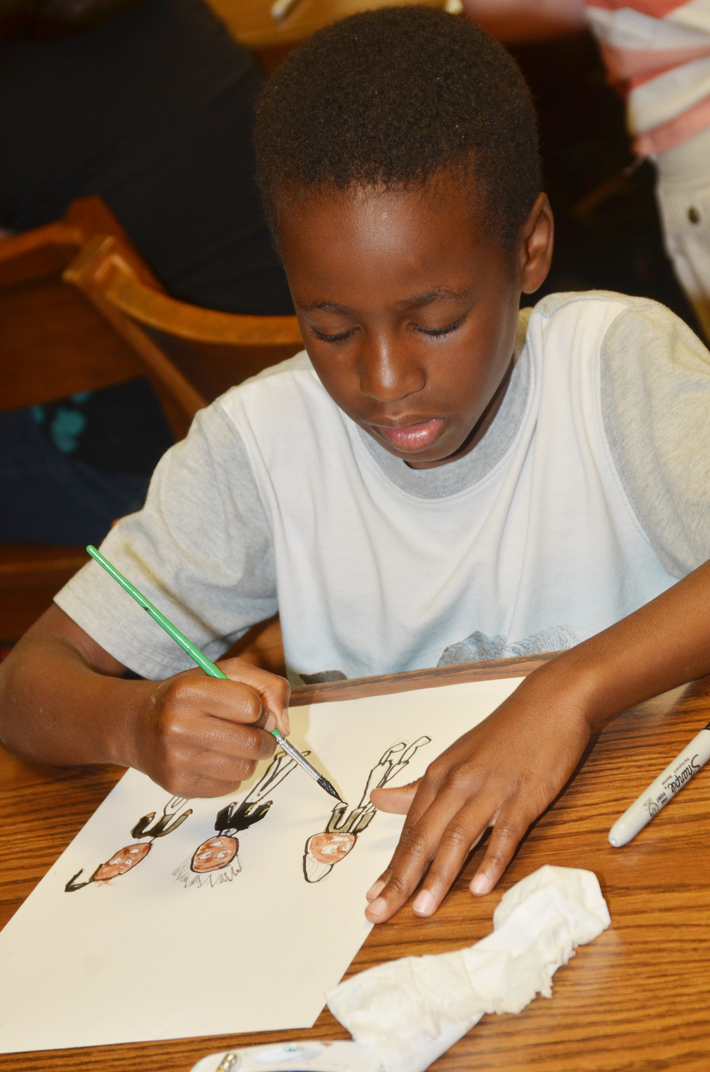 CES third-grader John Gholston paints.