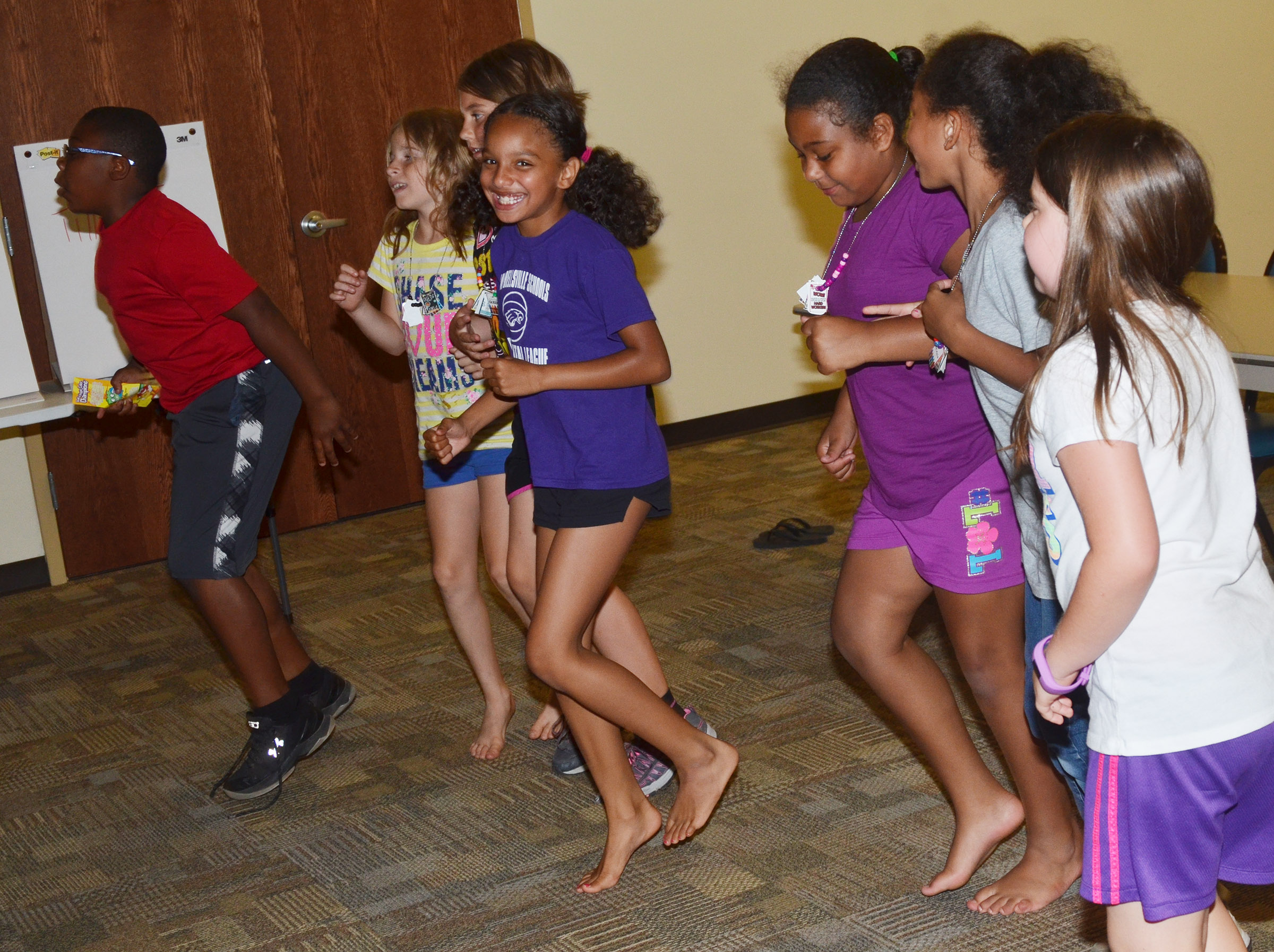 CES third-graders run in place together as part of their food groups game.