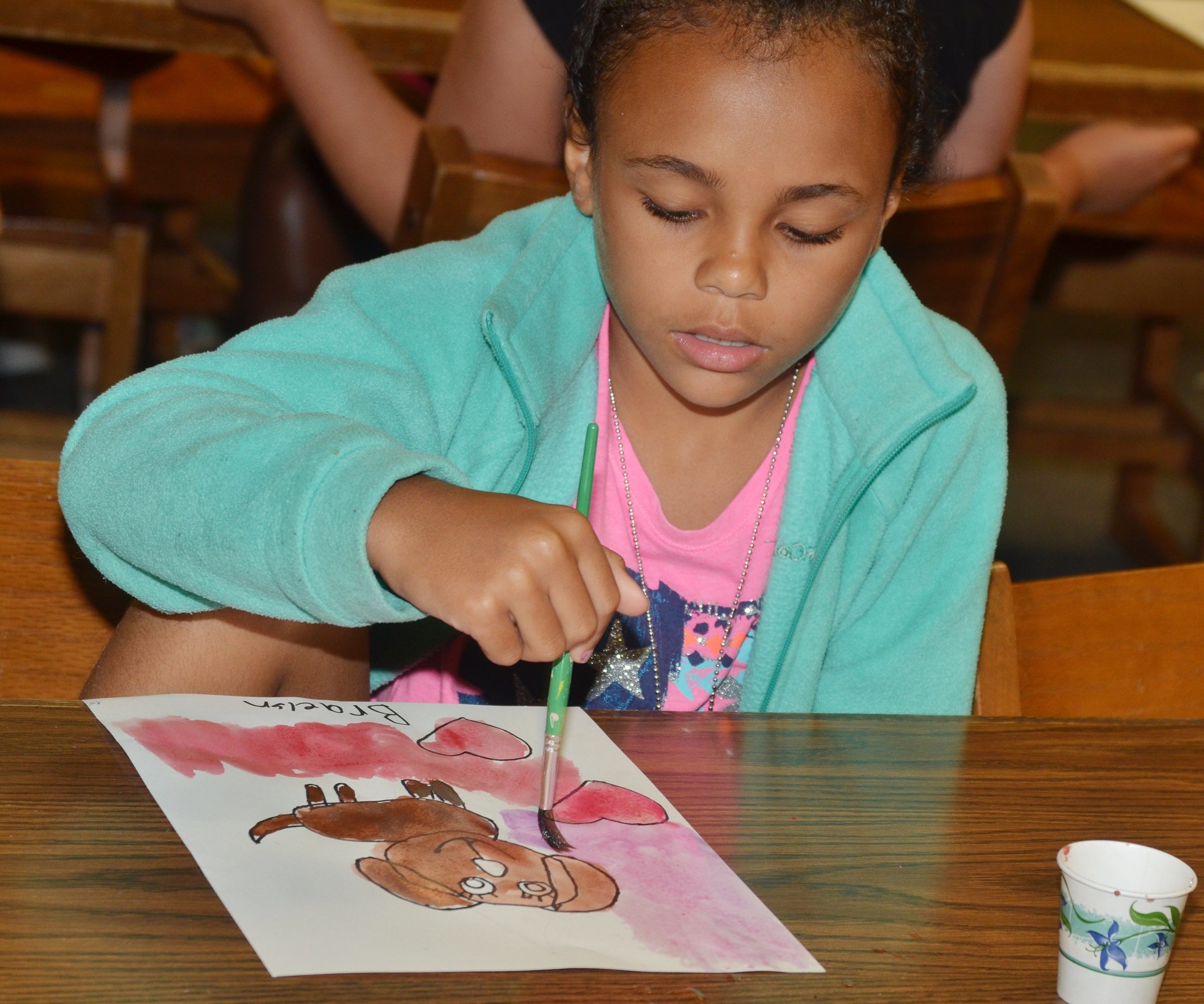 CES third-grader Braelyn Taylor paints.