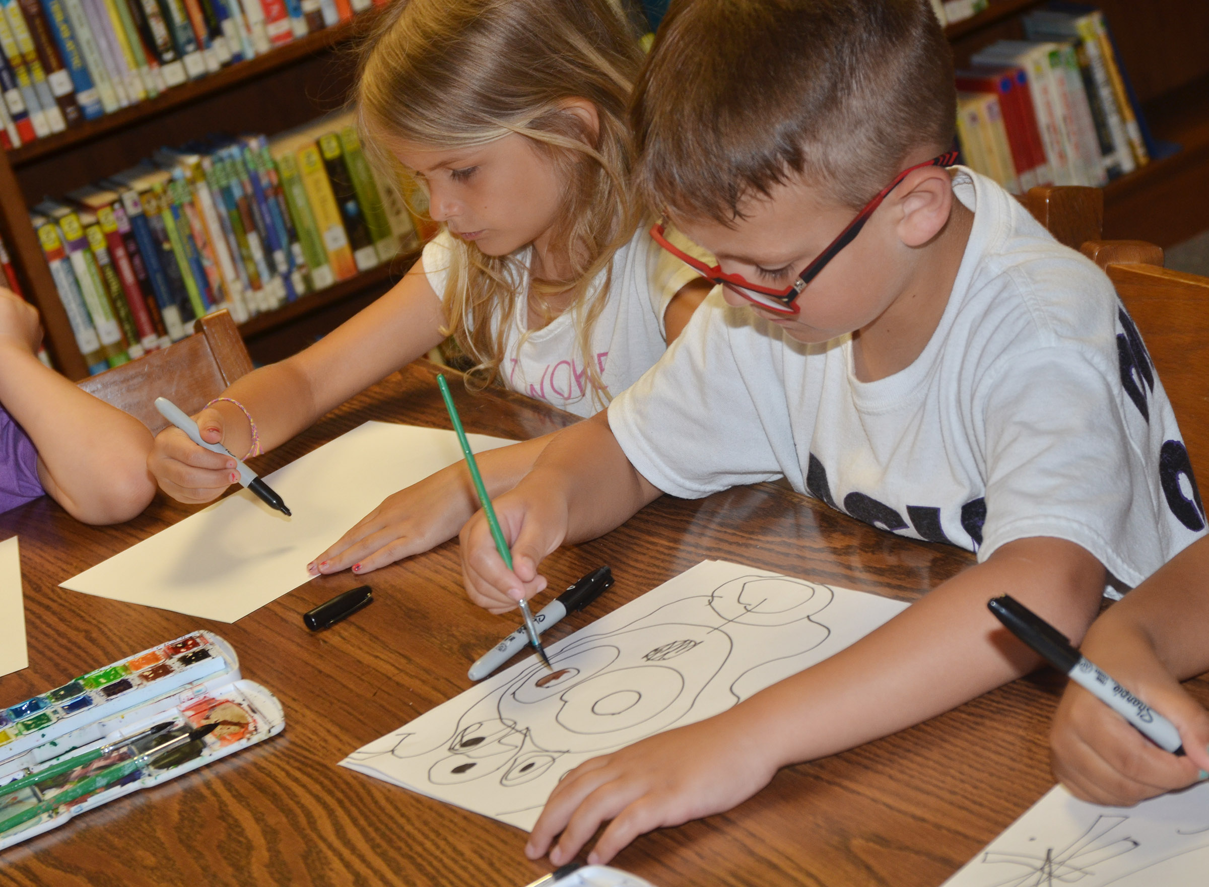 CES kindergartener Gracie Gebler, at left, and first-grader Brendan Martin paint.