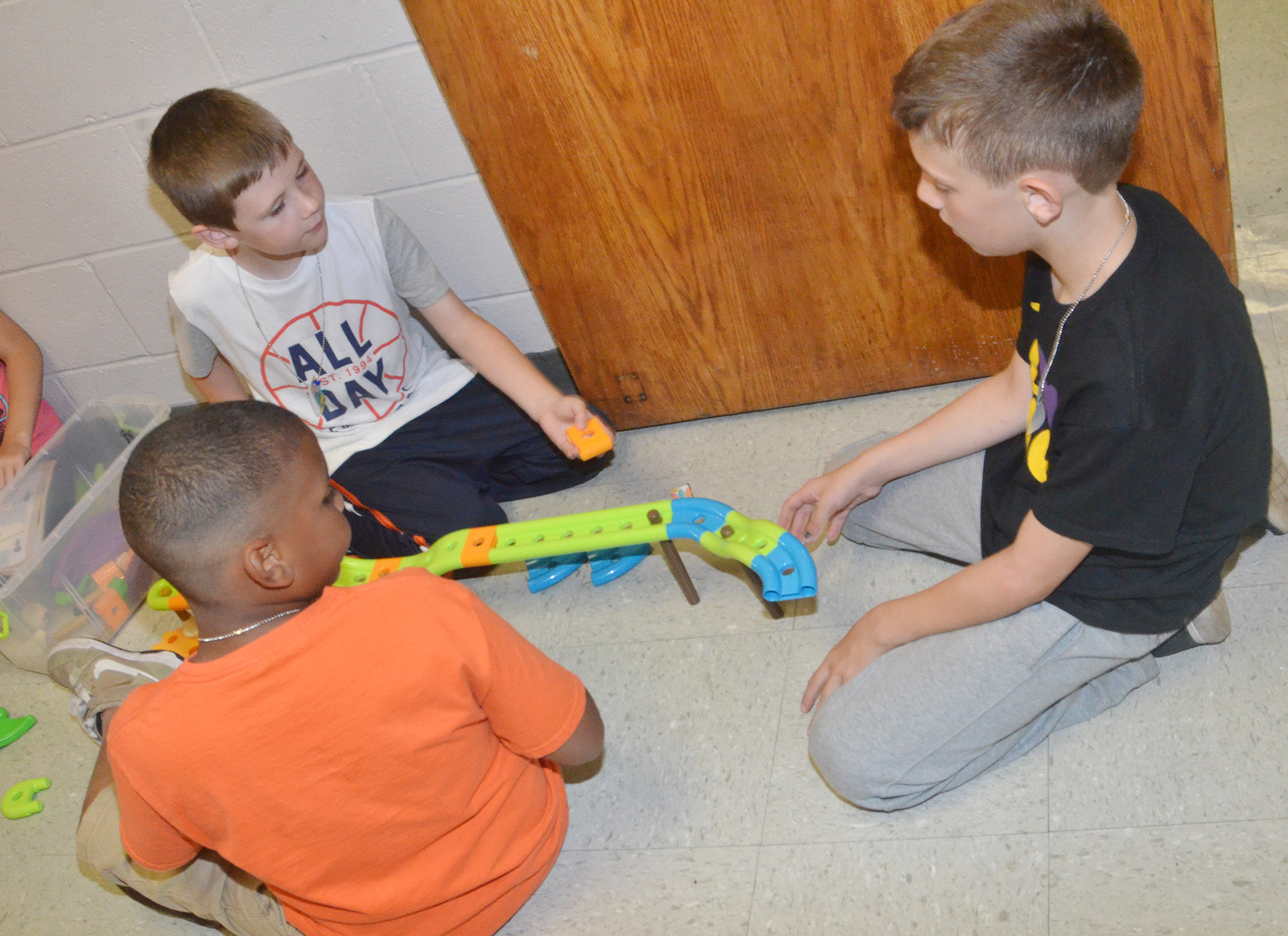 From left, CES second-graders Zaemar Hoskins, Ryan Tungate and Aidan Wilson build a race track.