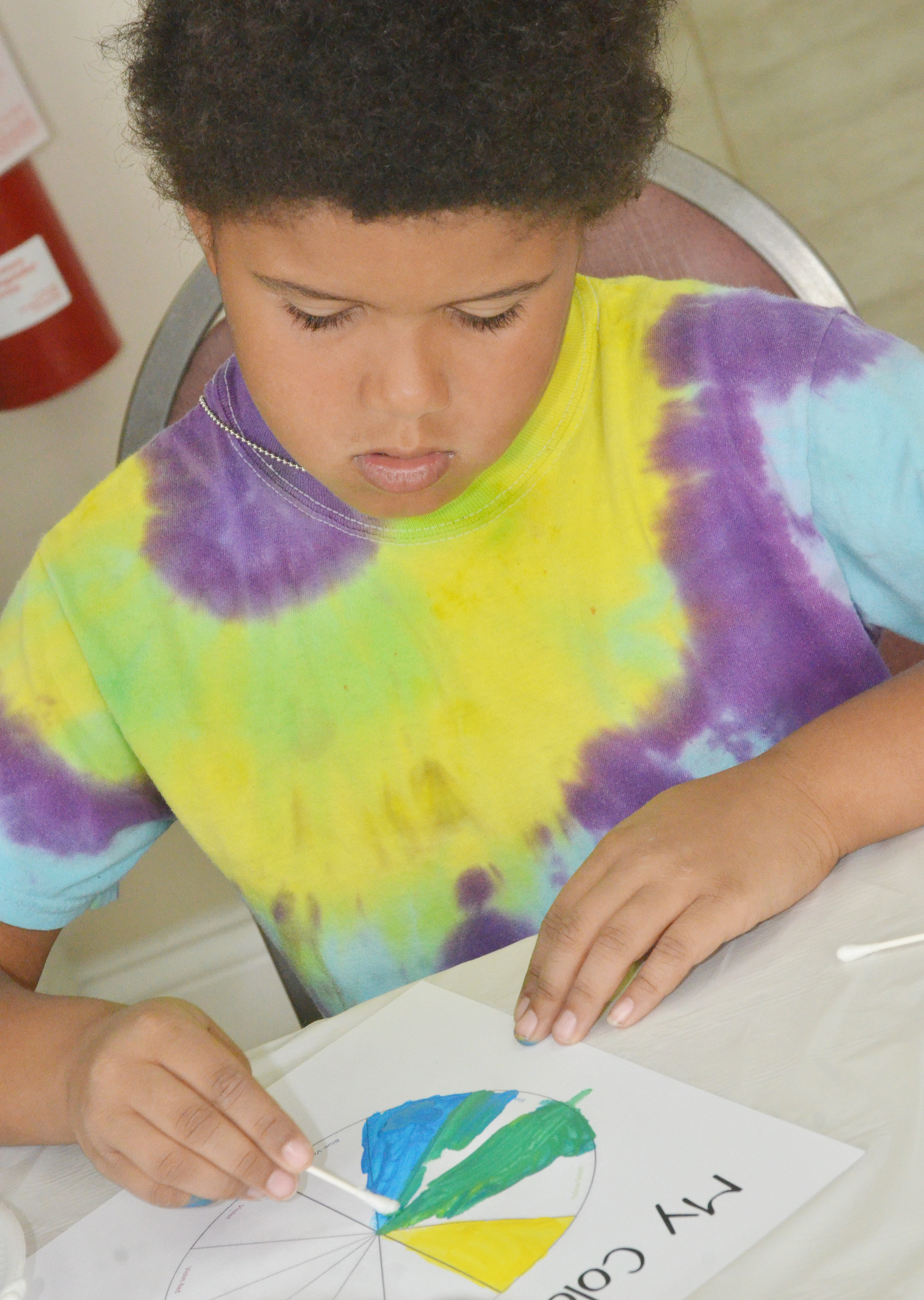 CES first-grader Navon Copeland creates his own color wheel.