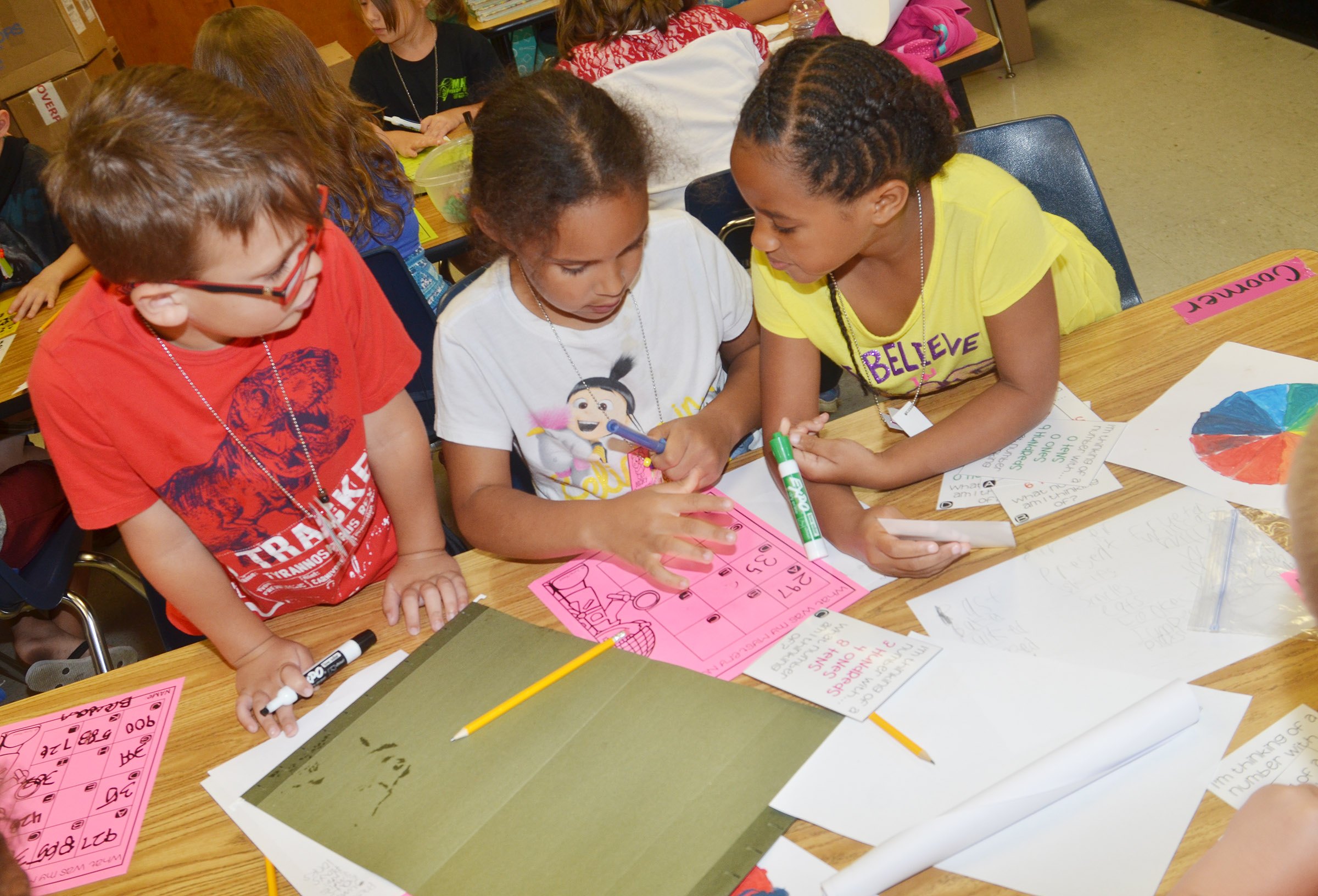 From left, CES first-graders Brendan Martin, Amani Bridgewater and Kadance Ford work math problems together.