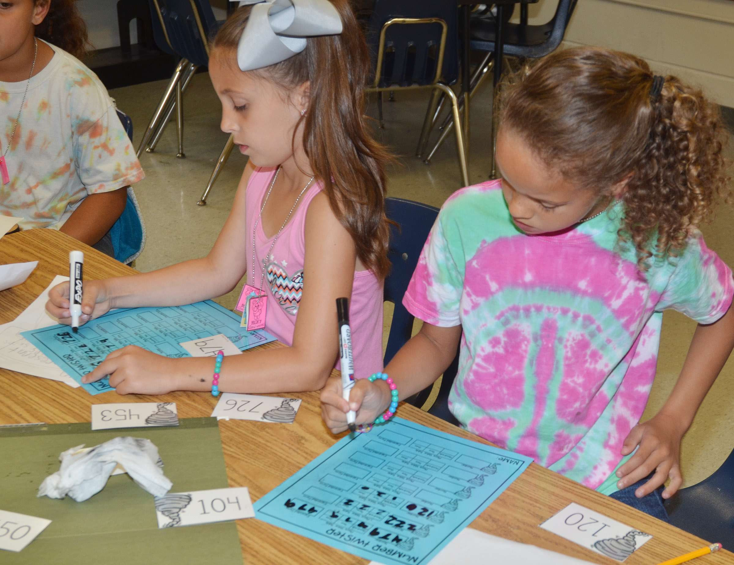 CES first-graders Lillian Martin, at left, and Keiava Thompson work math problems together.