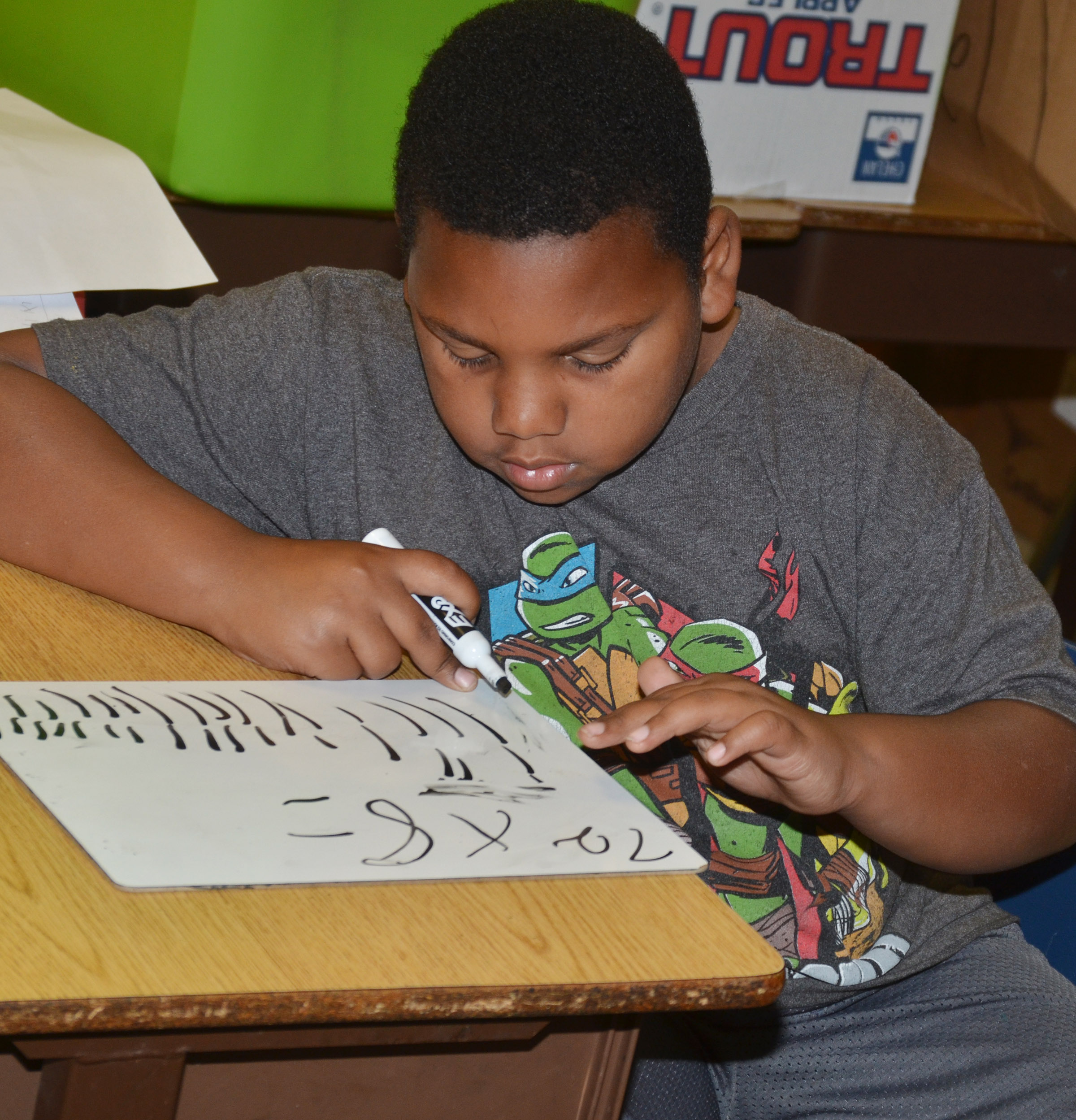 CES third-grader Malikiah Spurling works a math problem.