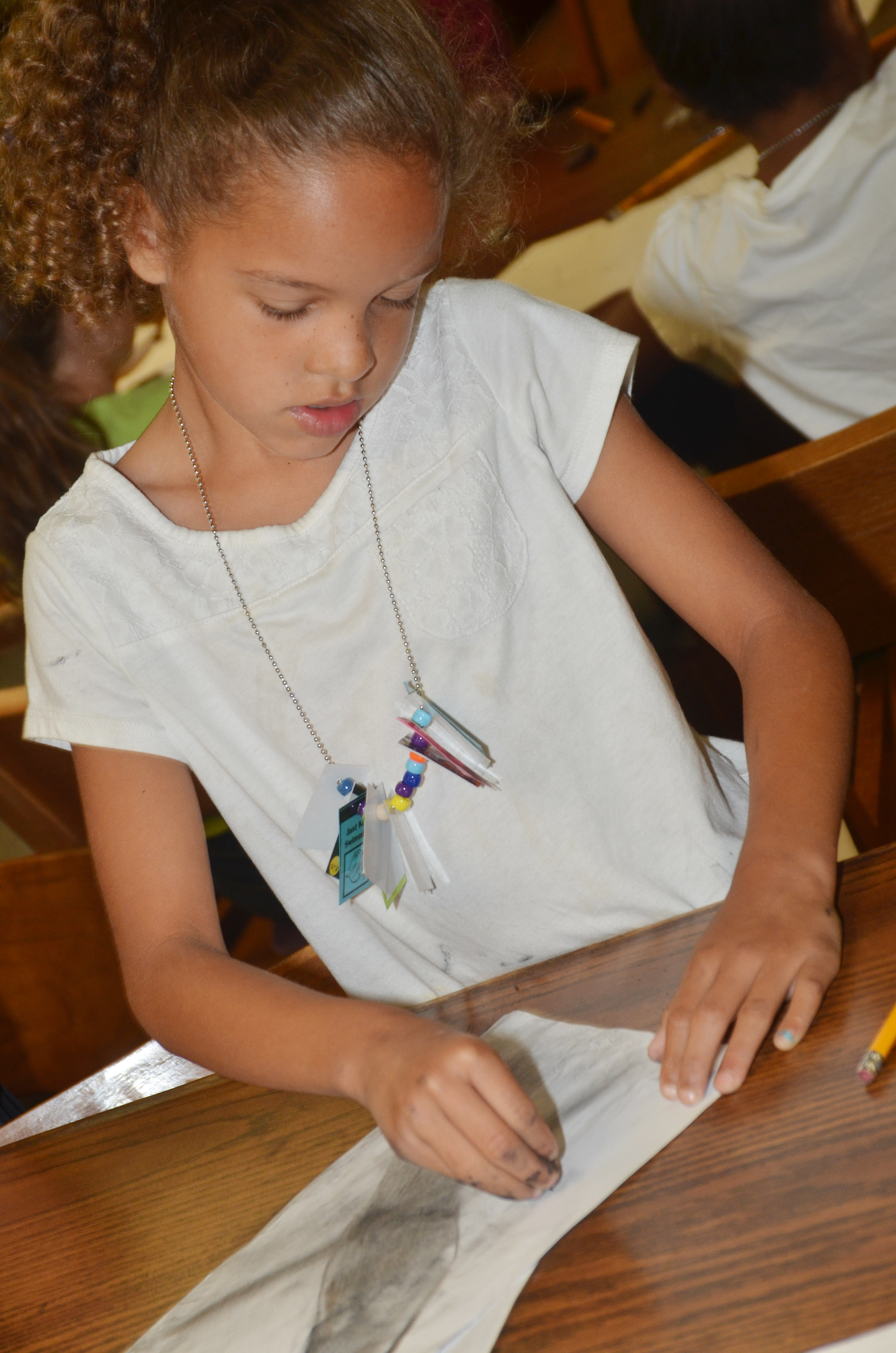CES first-grader Keiava Thompson draws with charcoal.