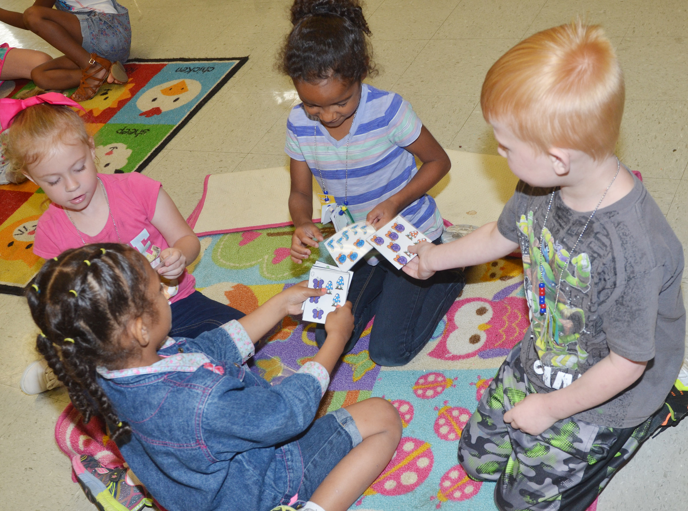 From left, CES kindergarteners Marlee Dickens, Ava Caffee, Kylei Thompson and Jayden Maupin practice counting.