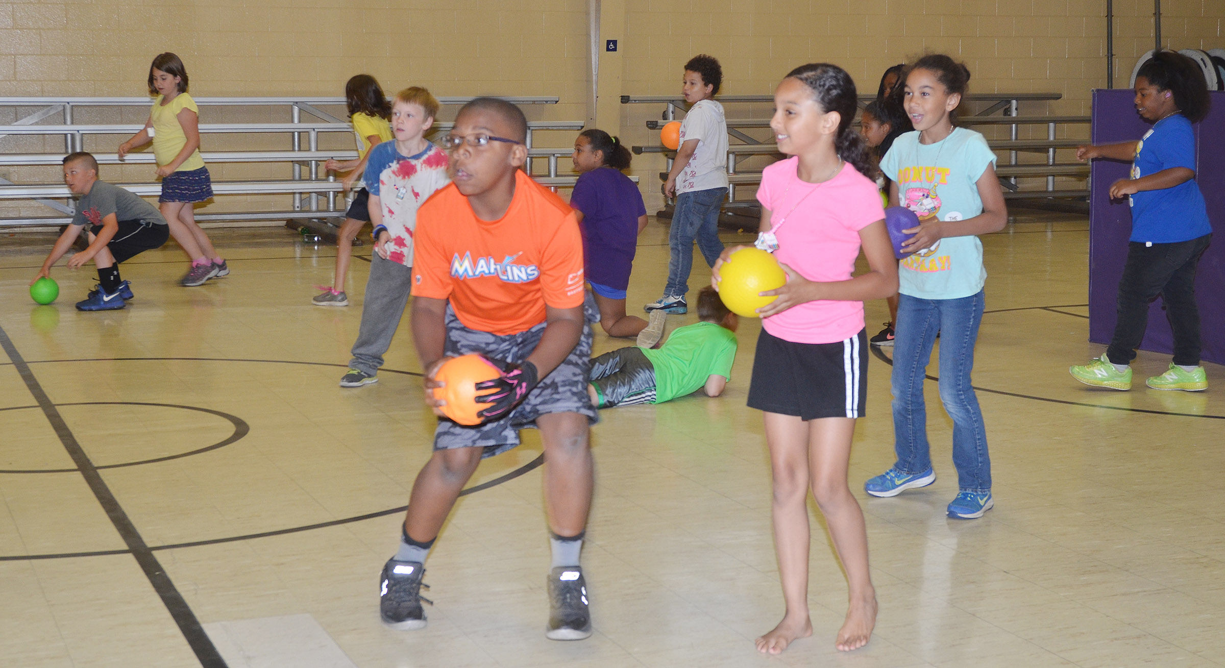 CES second- and third-graders battle each other in a game of dodgeball.