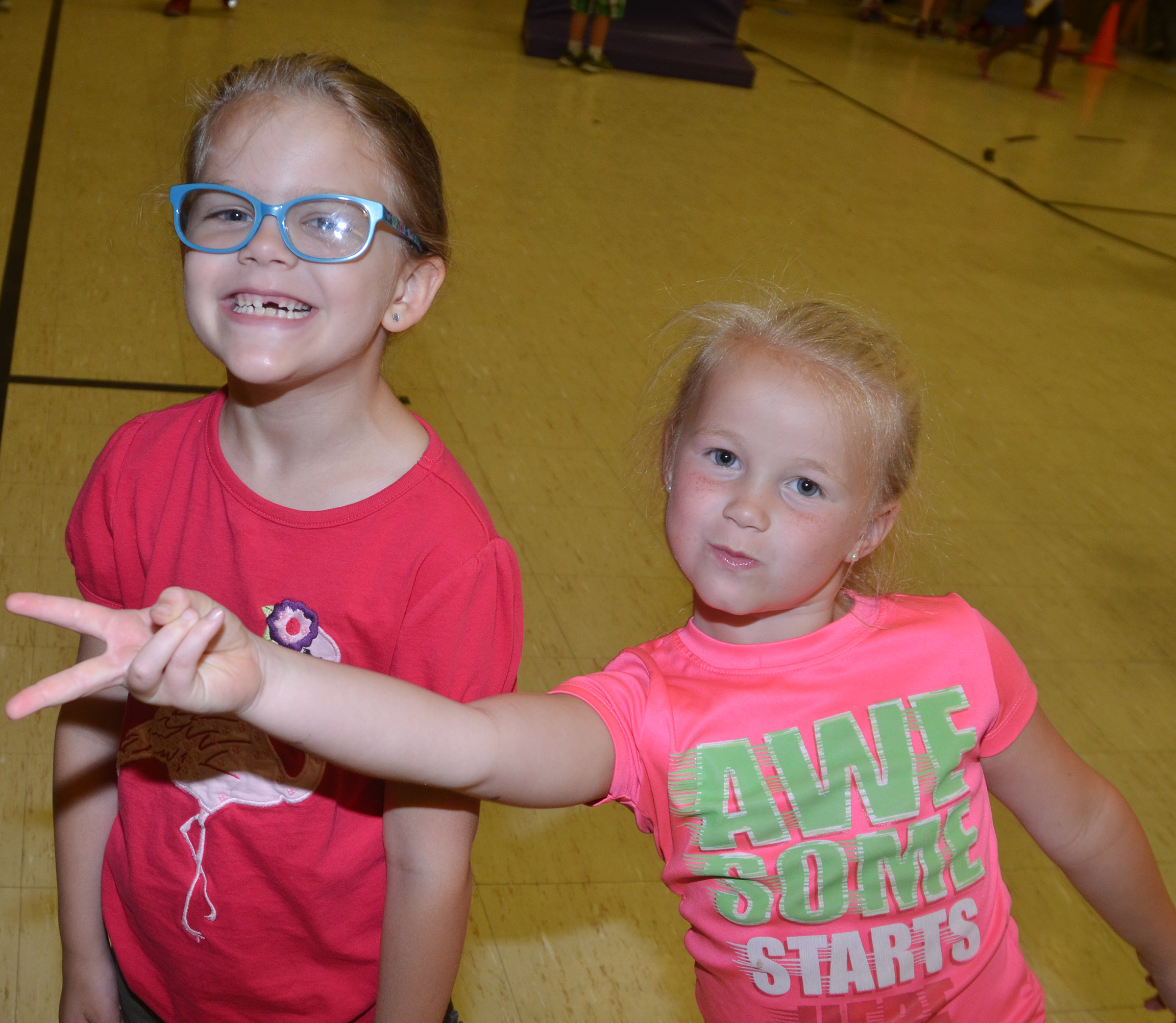 CES kindergarteners Zoe Weddle, at left, and Lillie Judd are all smiles for the camera.
