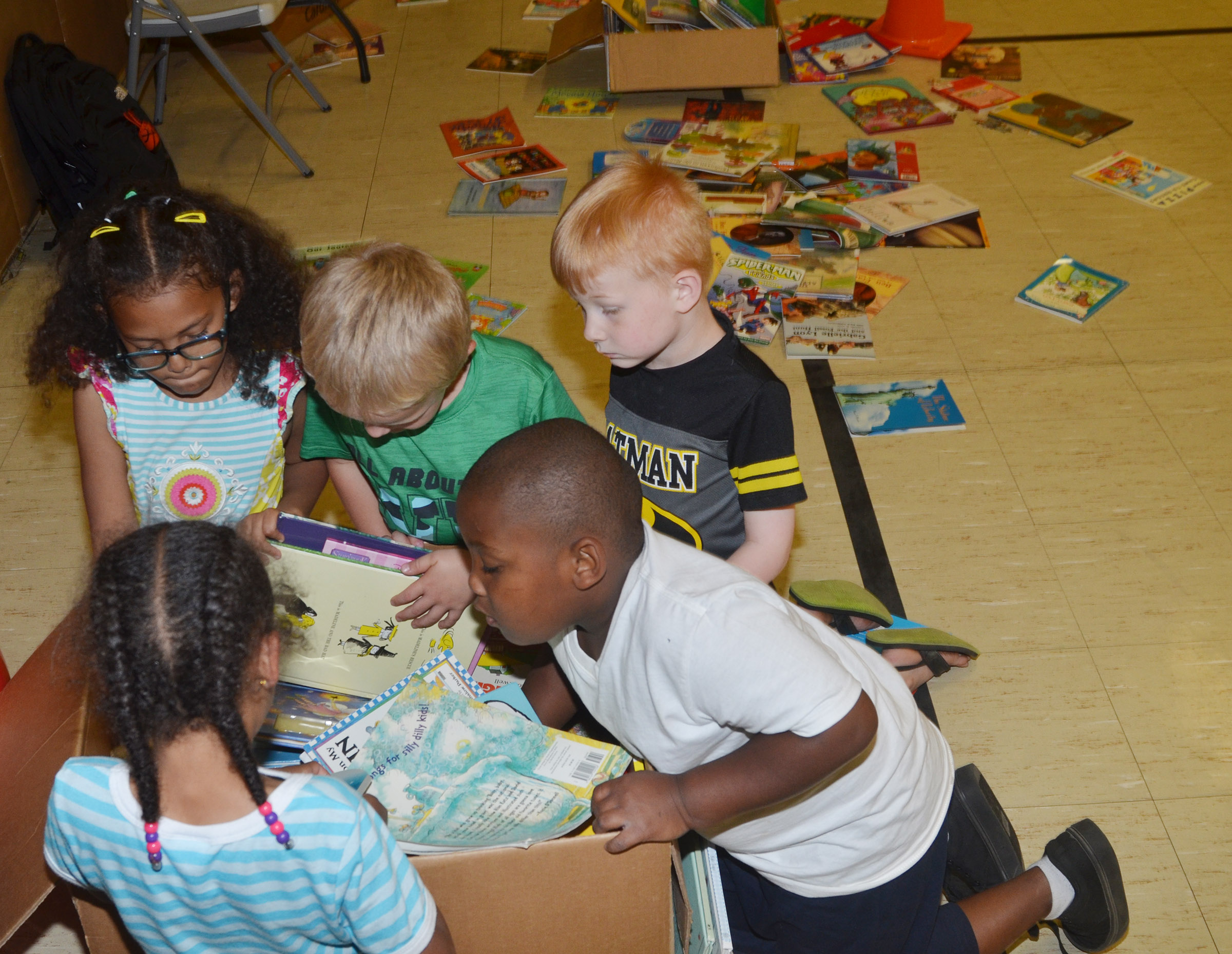 CES kindergarteners look for books to read, which were donated by the Lake Cumberland Community Action Agency.