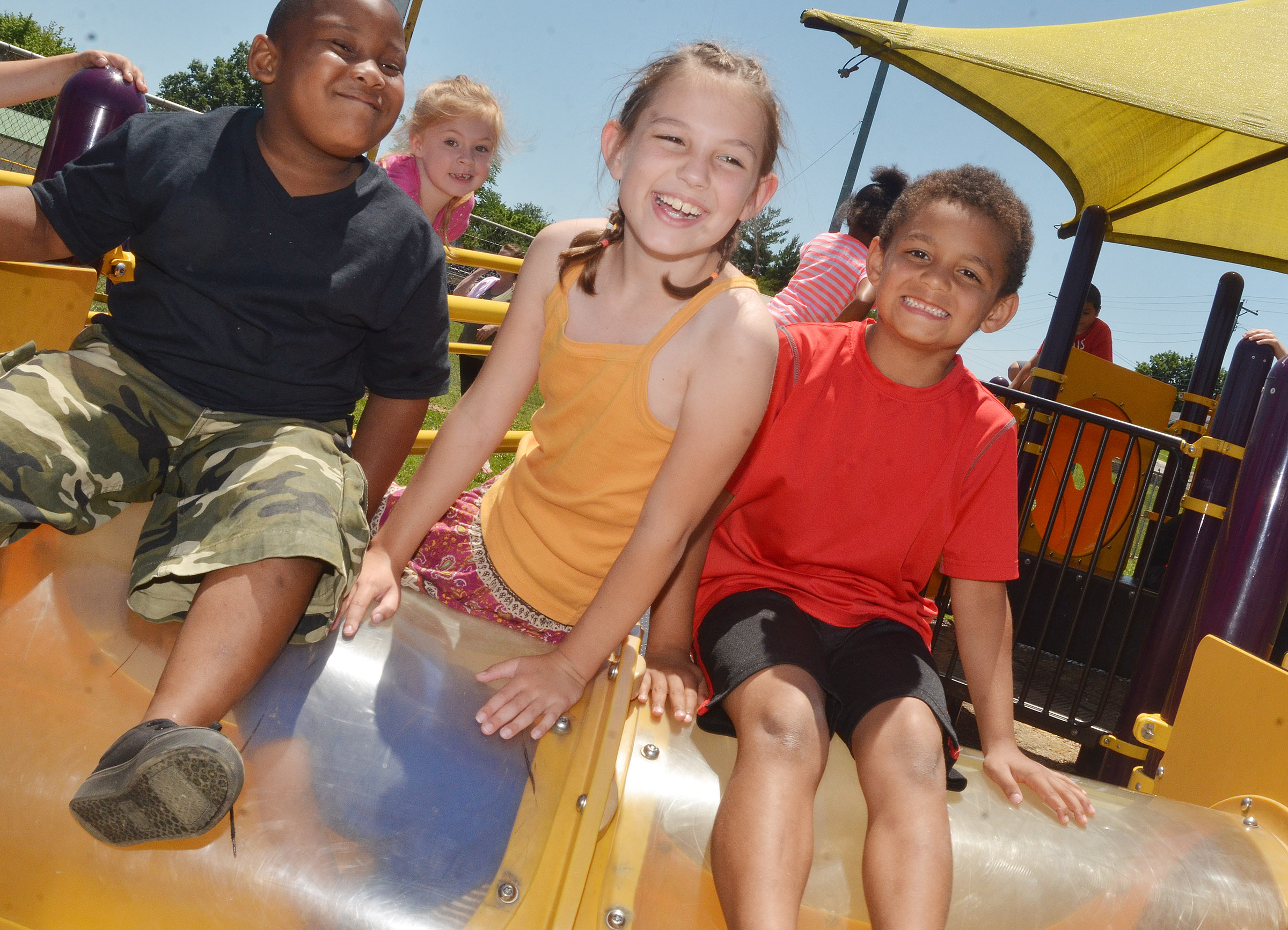 From left, CES kindergarteners Malachi Conner, second-grader Kairi Tucker and kindergartener Quincy Travis have fun together on the playground.