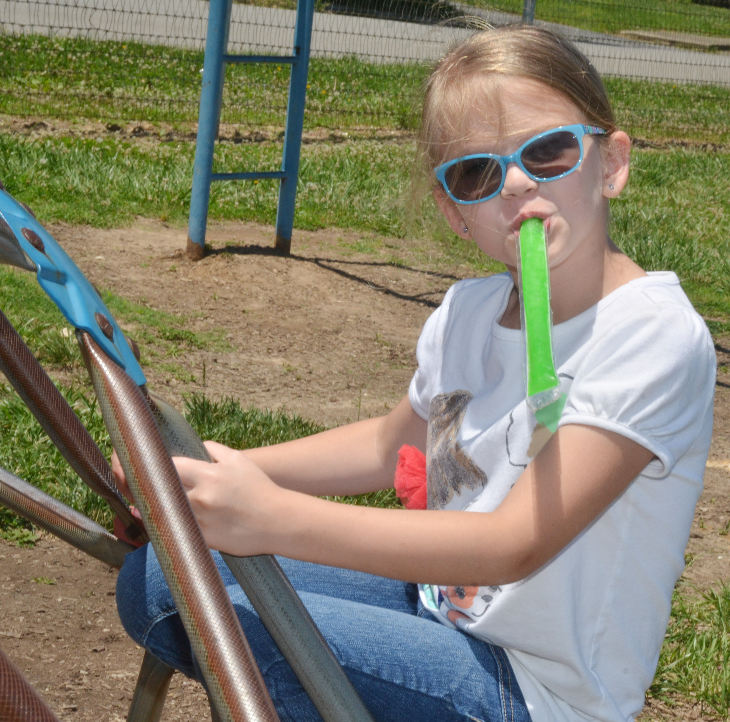 CES kindergartener Zoe Weddle enjoys a Popsicle on a hot day.