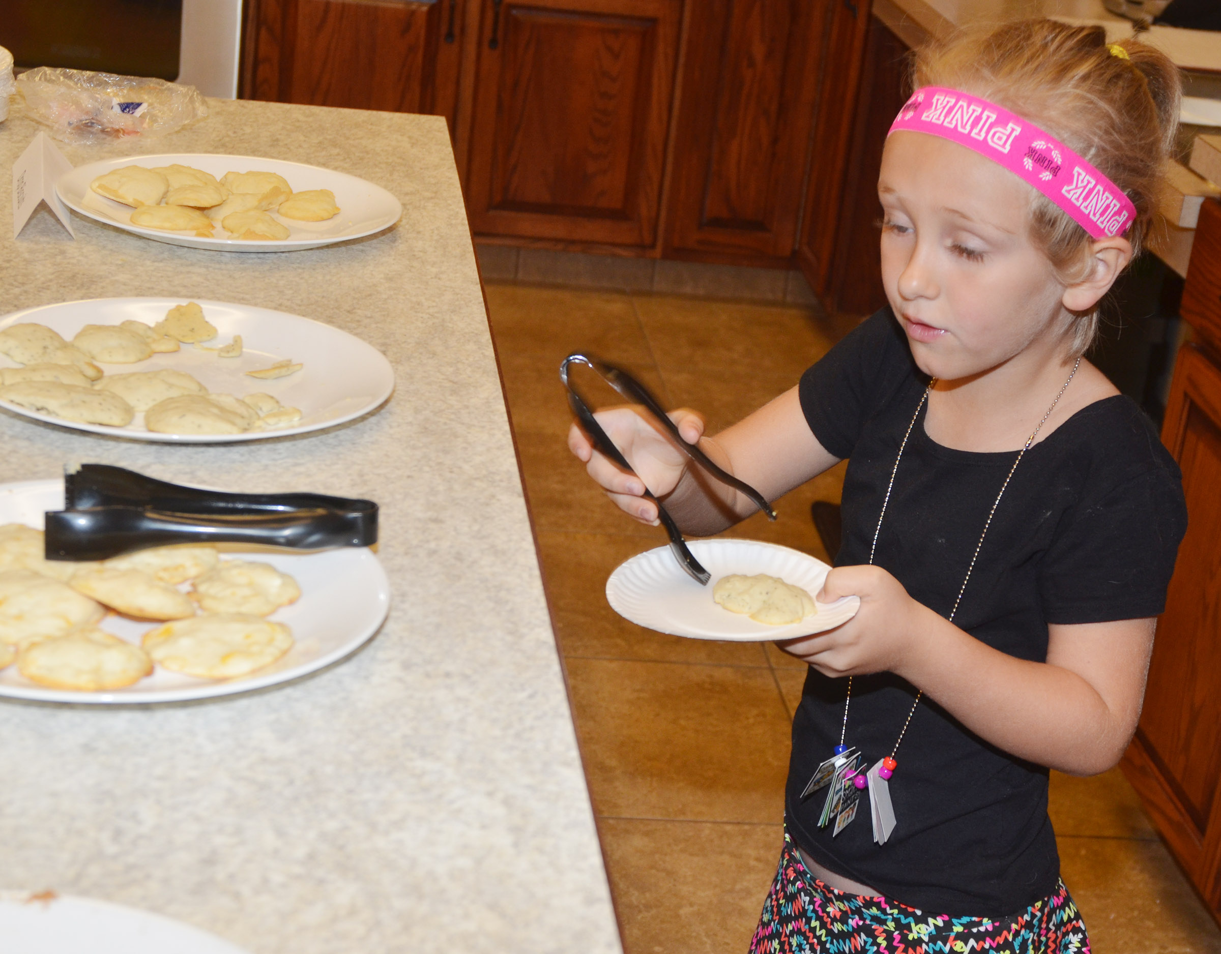CES kindergartener LeeAnna Garvin samples a biscuit that she and her classmates made together.