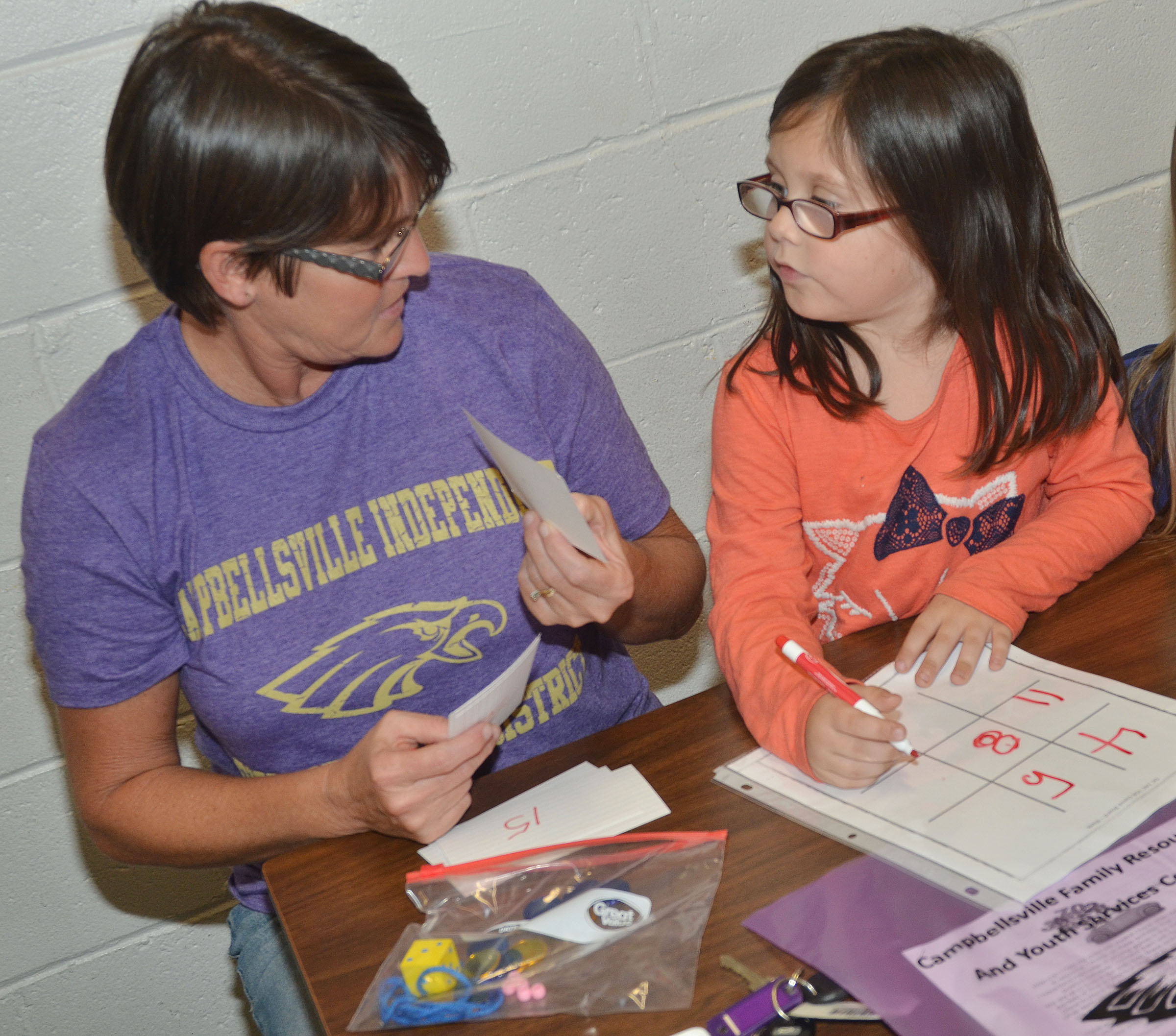 CES kindergartener Trinity Clark plays a math game with her grandmother, Bobbi Faulkner.