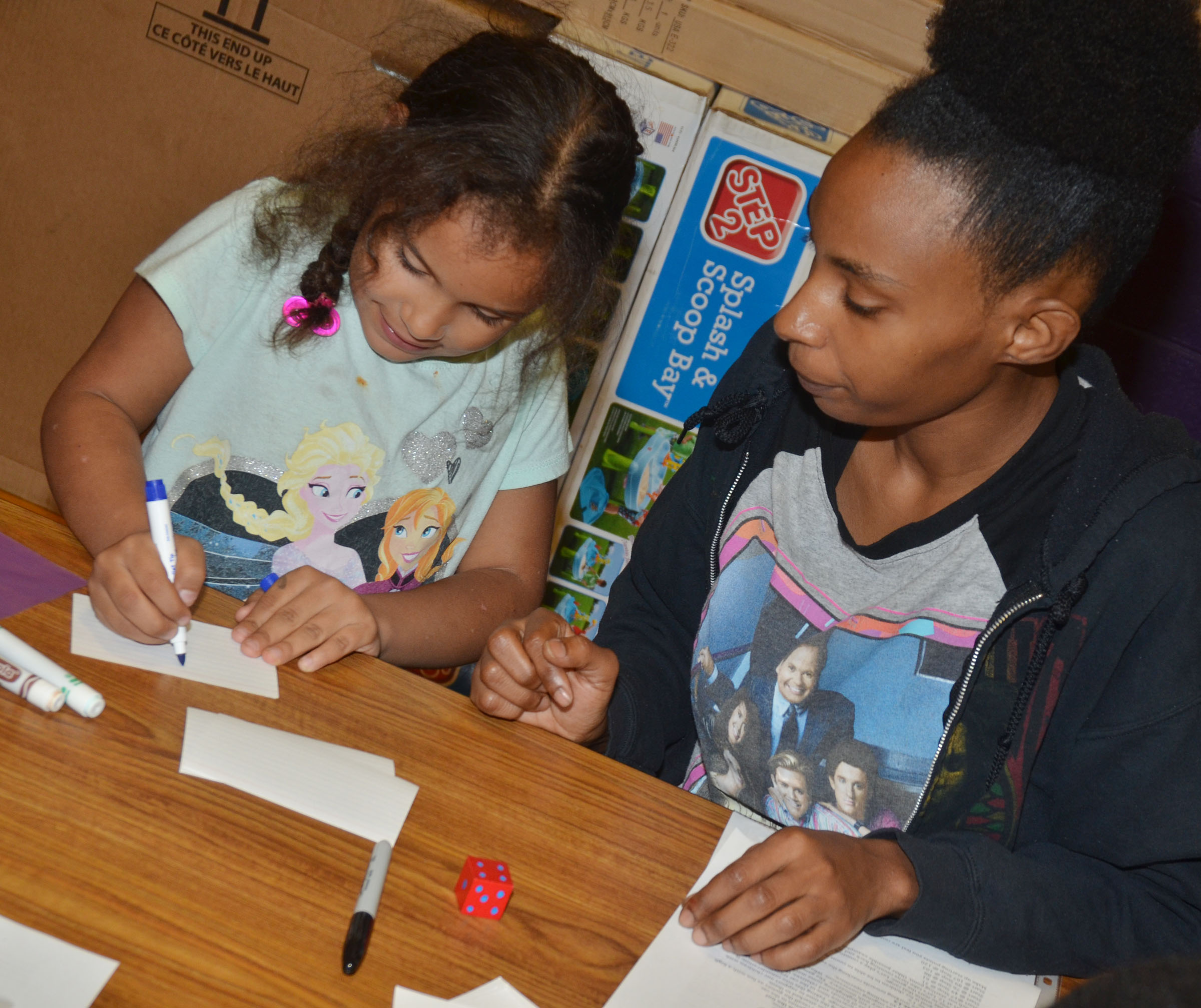 CES first-grader Amani Bridgewater plays a math game with her mother, TaKara.