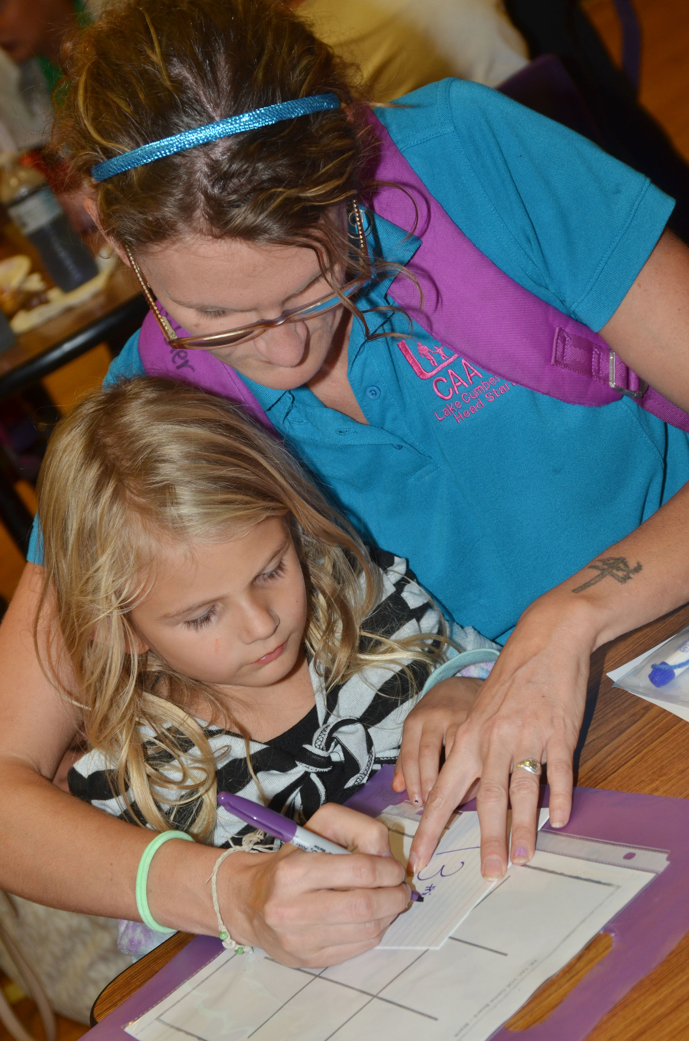 CES kindergartener Gracelyn Gebler plays a math game with her mother, Rebekah Taylor.