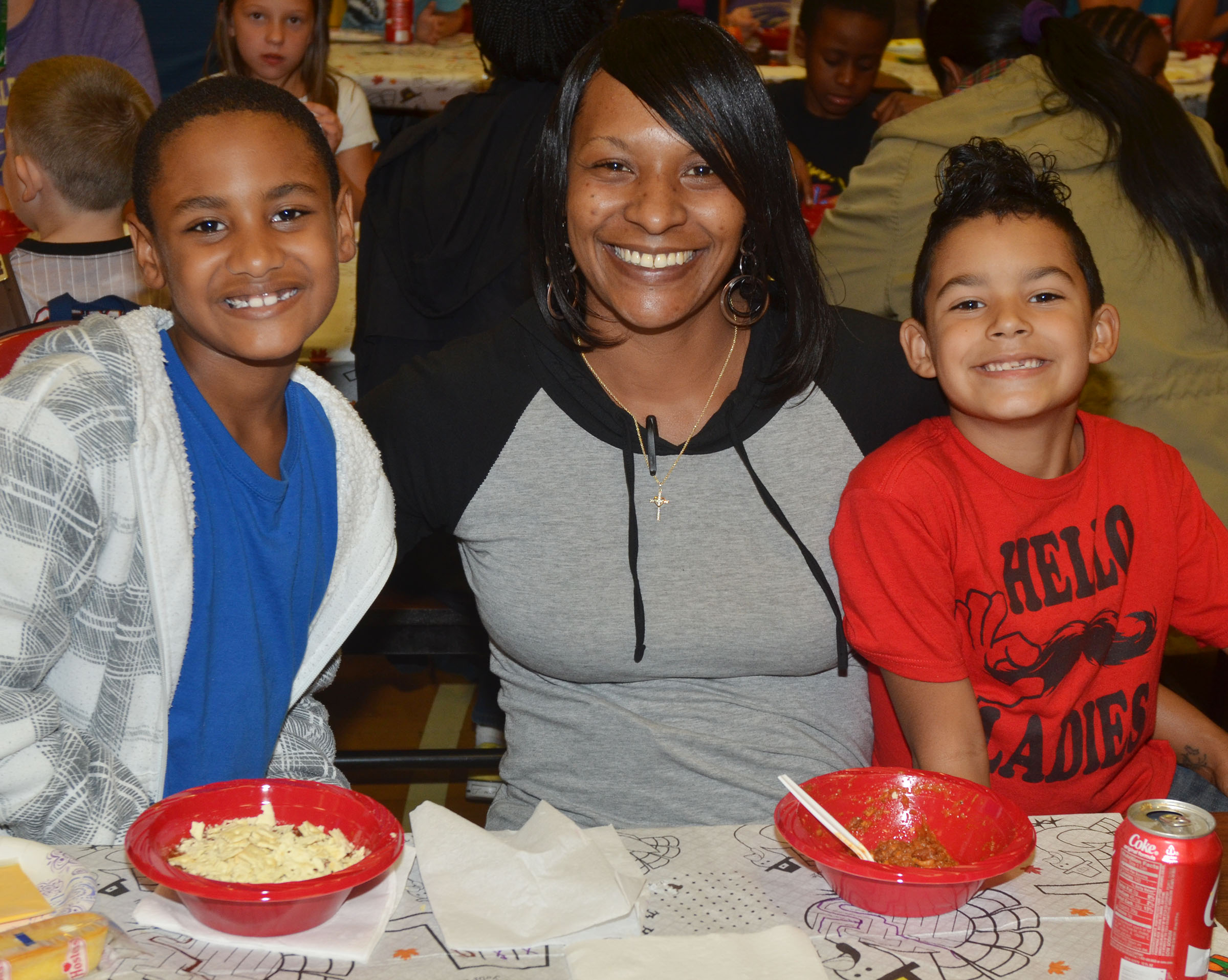 CES third-grader Shaiden Calhoun, at left, and first-grader Rizzo McKenzie, at right, pose for a photo with their mother, Chanda Calhoun.
