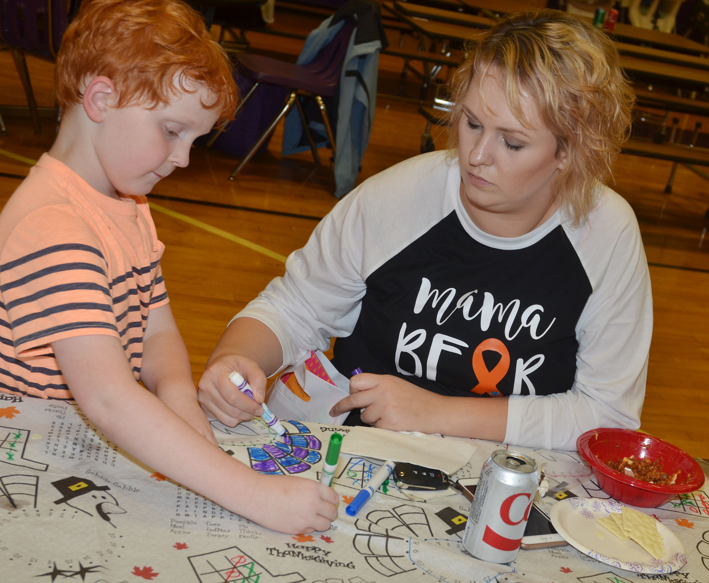 CES second-grader Gavin Martin colors with his mother, Alex.